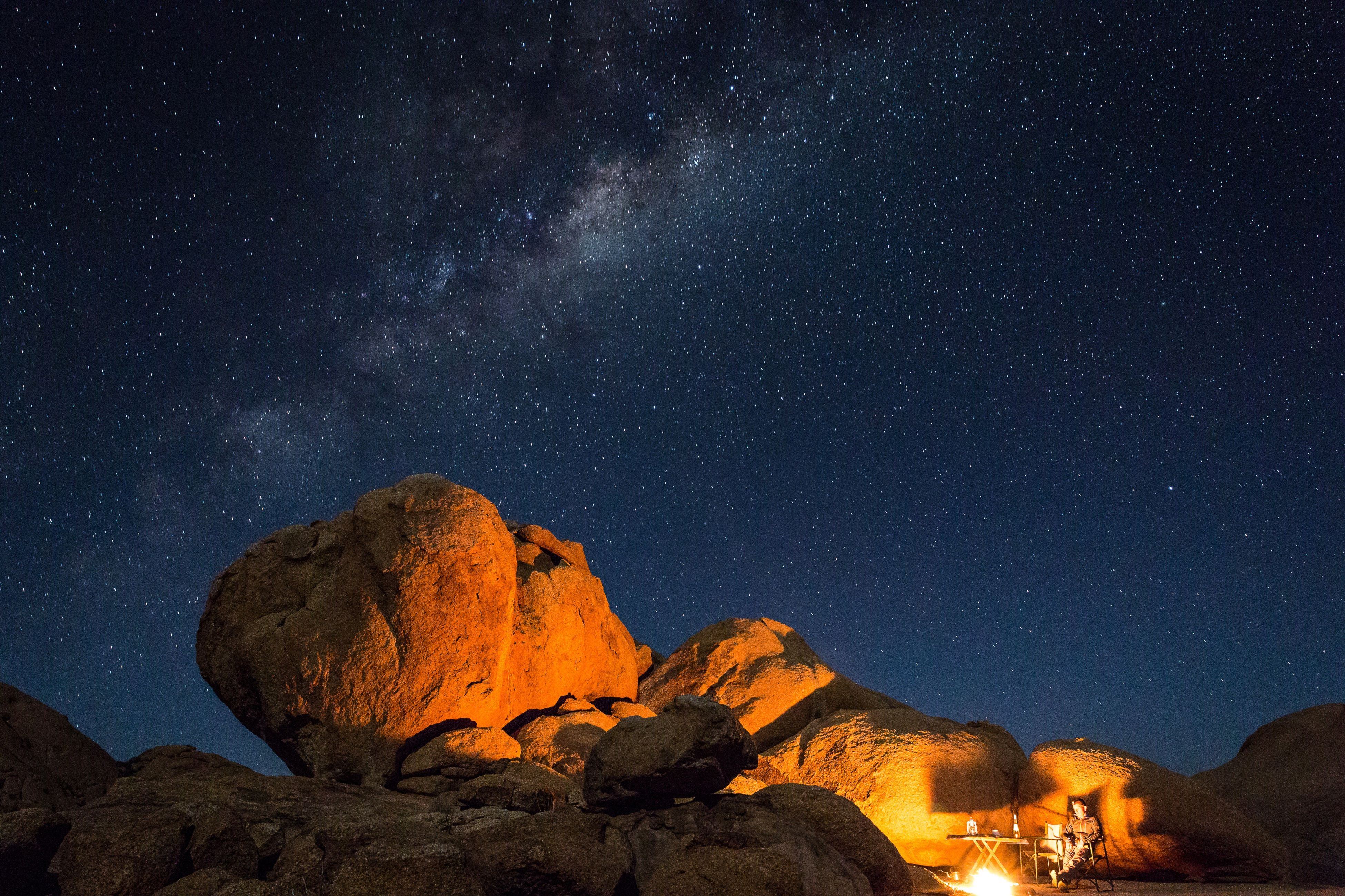 night, star - space, star field, astronomy, scenics, tranquil scene, beauty in nature, tranquility, star, galaxy, sky, low angle view, nature, space, idyllic, constellation, infinity, dark, majestic, landscape, rock formation, mountain, outdoors, no people, non-urban scene, remote, illuminated, non urban scene