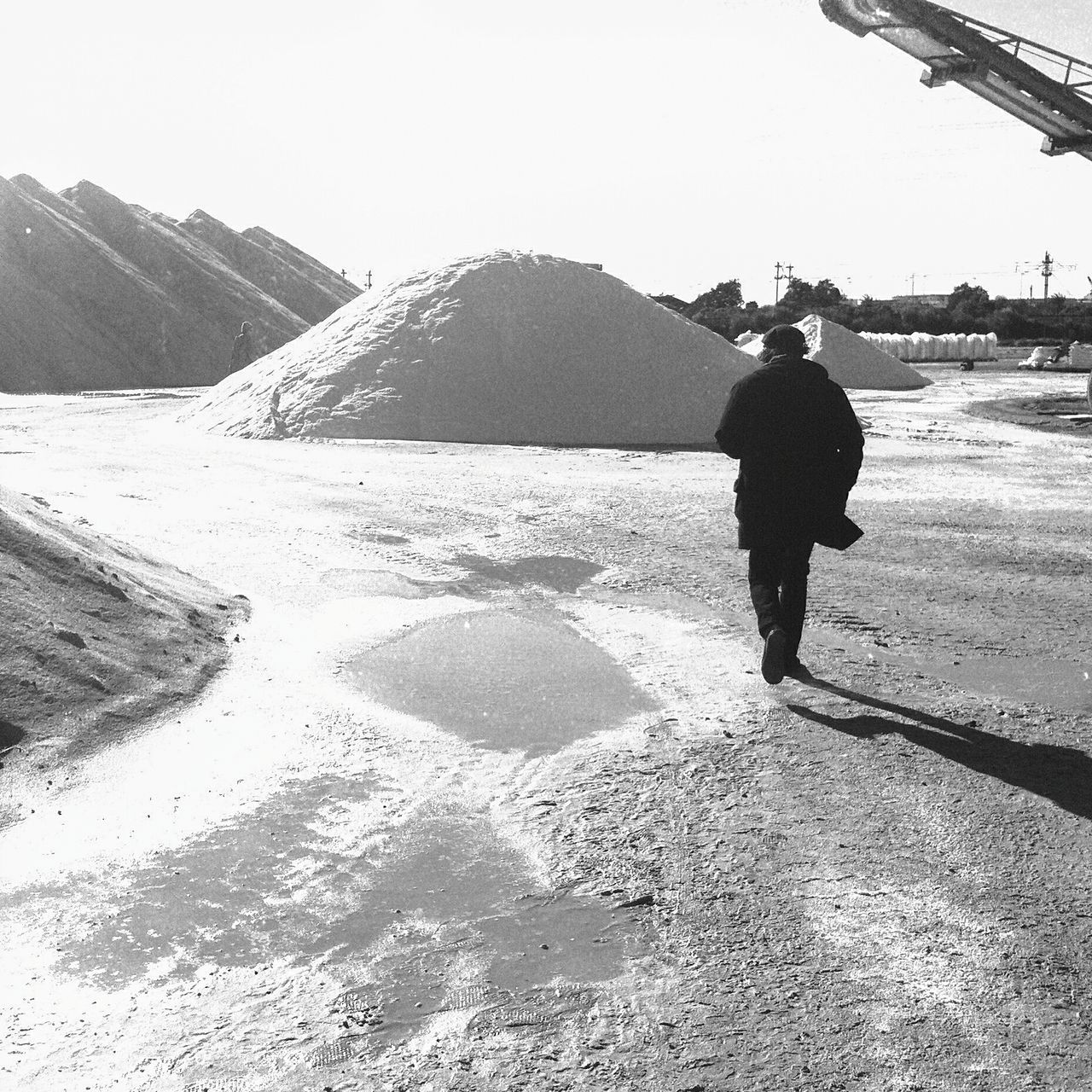 Blackandwhite Salt Salt Works Shadow Real People Walking Alone... Treading Back View Go Away People Outdoors Landscape Shine White Light