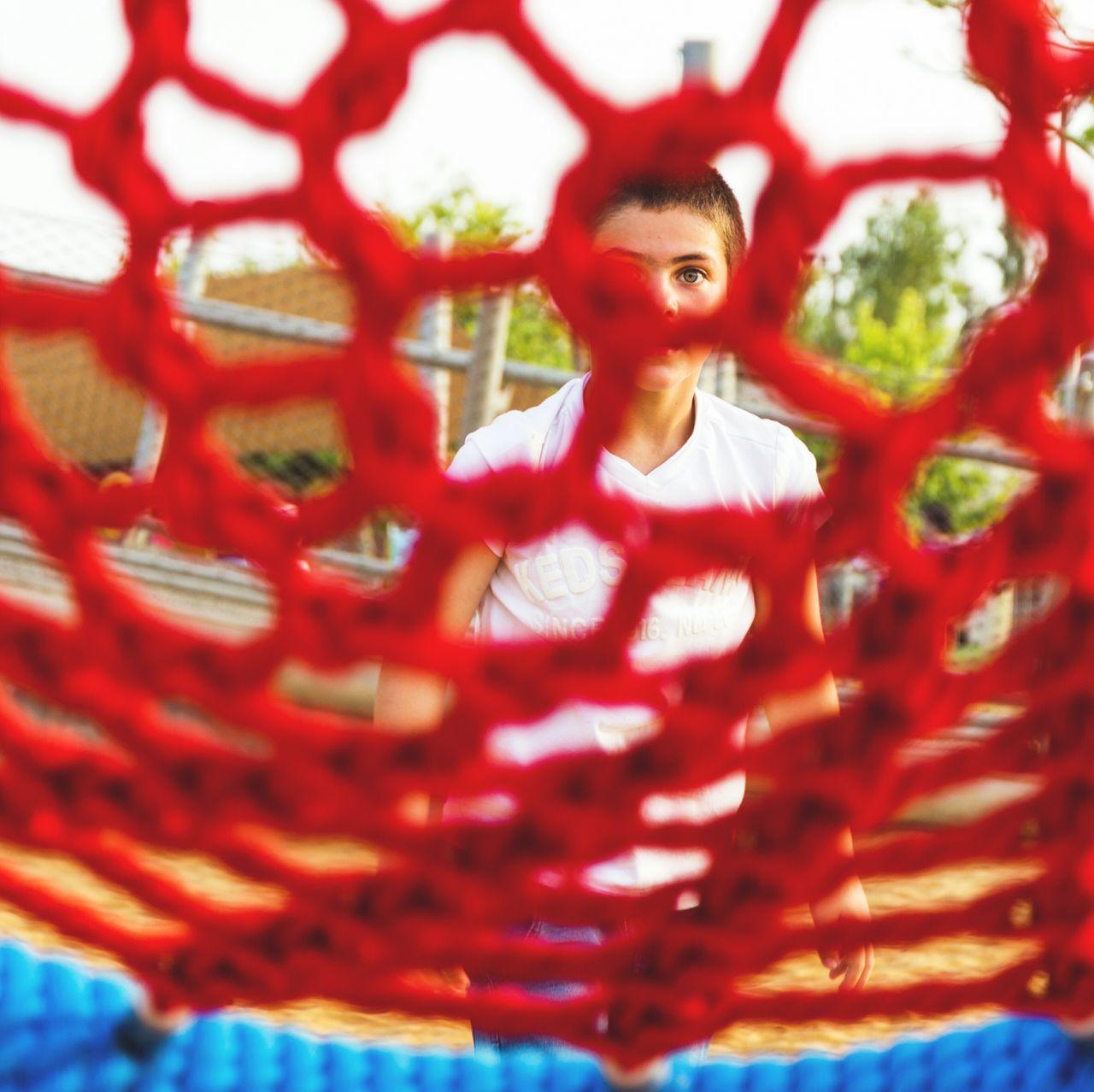 Boy Seen Through Jungle Gym At Playground