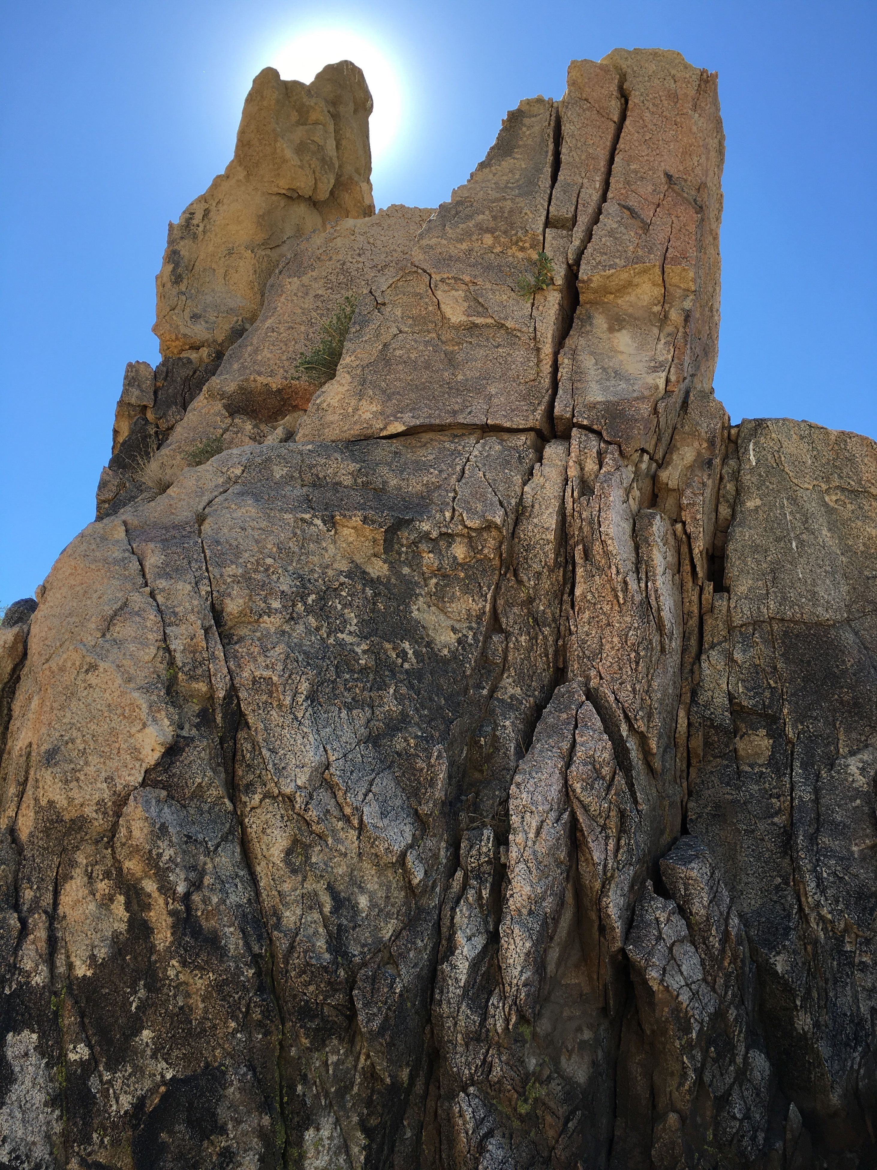 low angle view, sky, weathered, rock formation, nature, the past, outdoors, no people, tourism, beauty in nature, geology, cloud - sky, rocky, tranquility, history, famous place