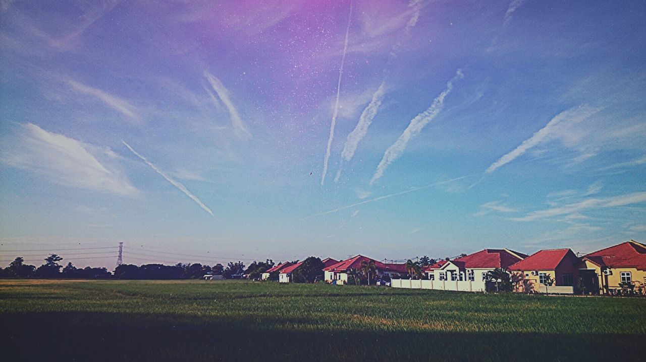 sky, field, house, no people, landscape, blue, nature, built structure, tranquility, beauty in nature, architecture, outdoors, scenics, grass, building exterior, day, vapor trail