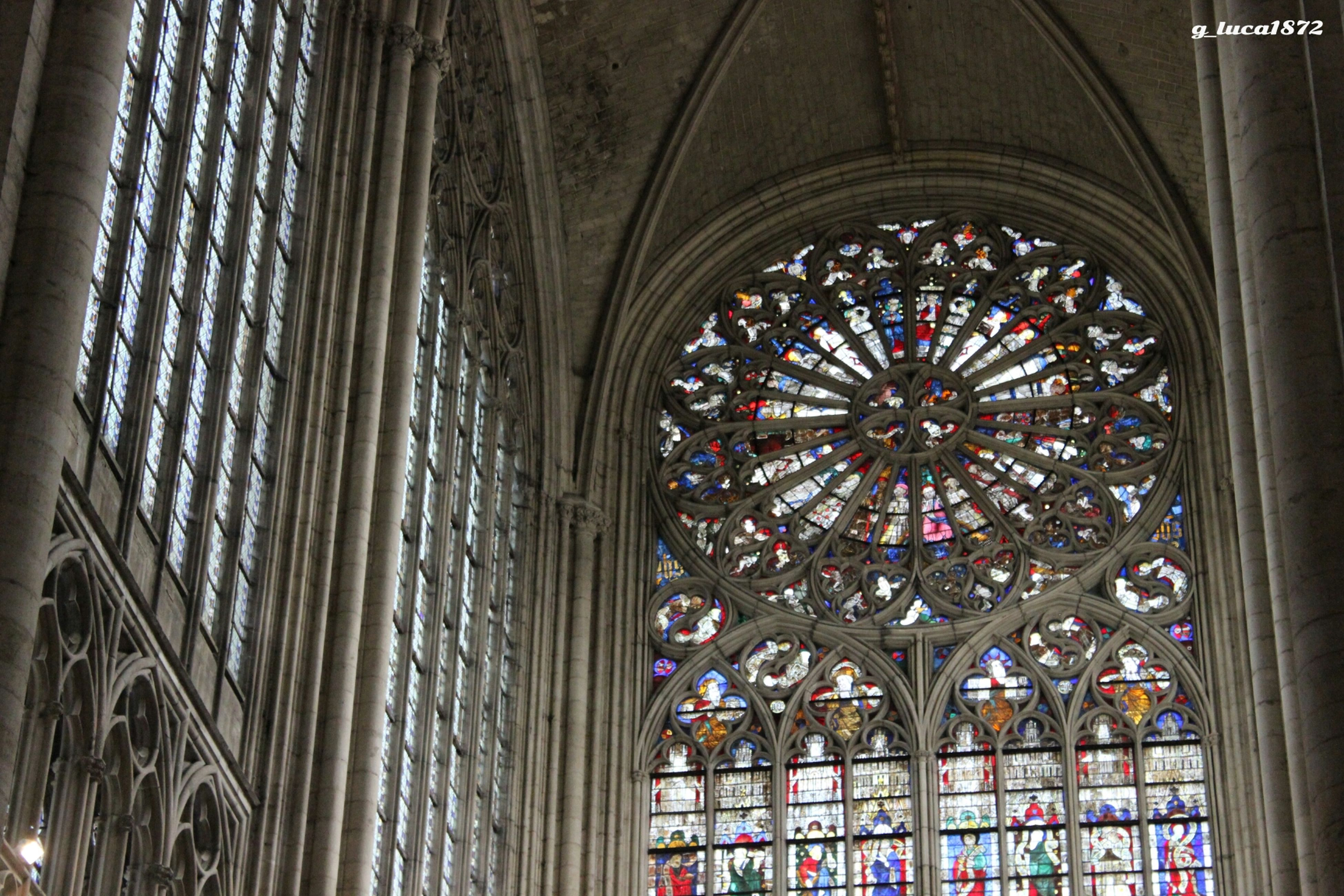 indoors, place of worship, religion, low angle view, architecture, spirituality, church, built structure, window, ornate, stained glass, ceiling, cathedral, design, pattern, architectural feature, art and craft, no people