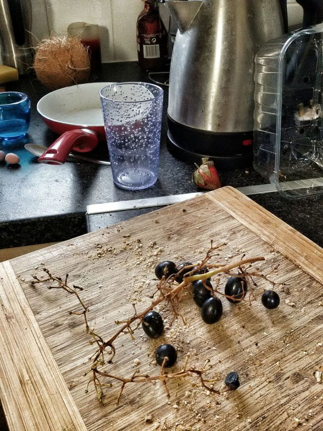Grapes on shopping board. Kitchen Grapes Chopping Board Mess Kettle Glass Pan Still Life Home Environment Objects Cooking At Home