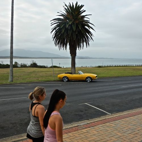 1/12/2017 Automobile Car Convertible Day Friendship Holiday Horizon Horizon Over Water Leisure Live For The Story Ocean Ocean View Outdoors Palm Tree Real People Sea Seaside Sky Togetherness Two People Vacation Walking Waterfront Women Yellow Car