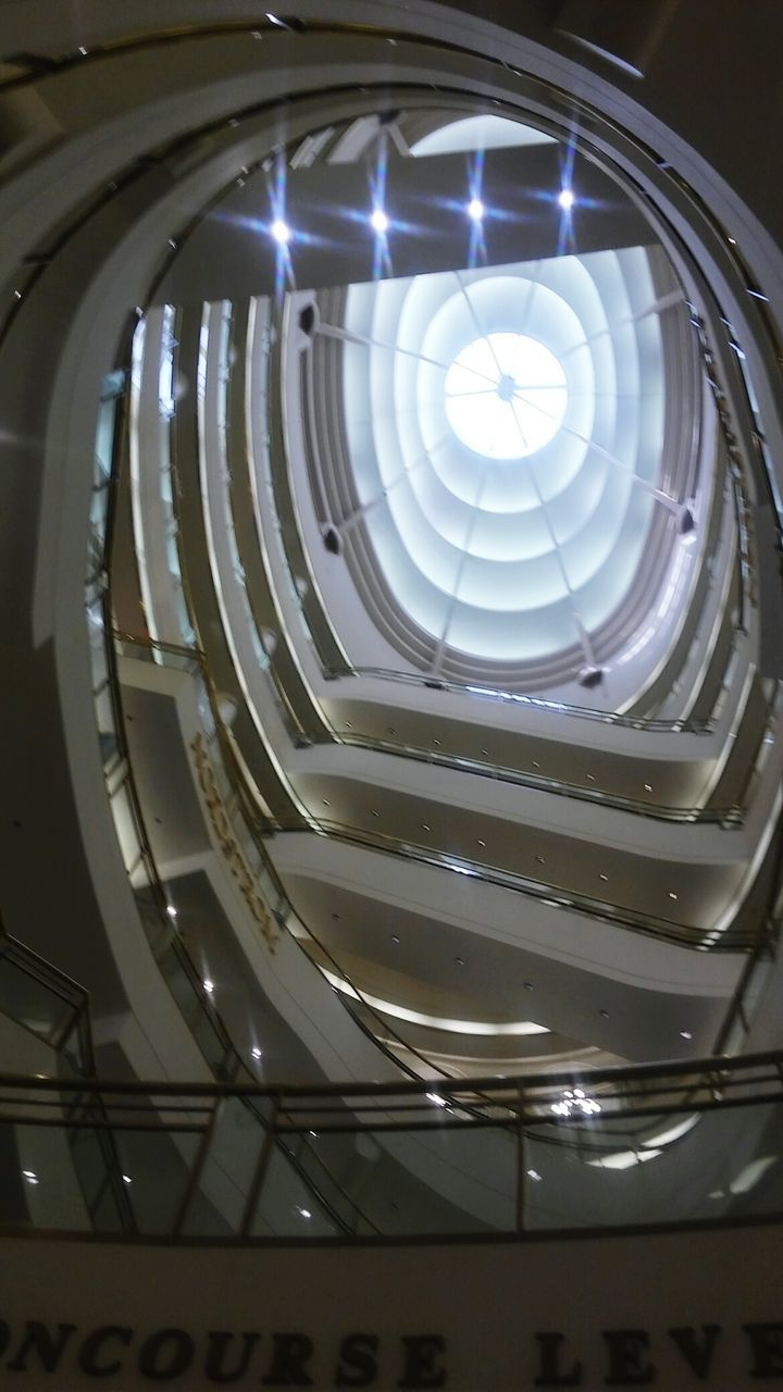 indoors, architecture, steps and staircases, built structure, low angle view, no people, illuminated, spiral staircase, close-up, day