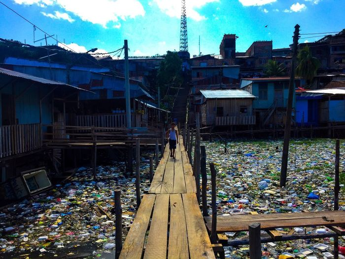 The end of human's shits in Amazon. Real People Day One Person Outdoors Men Standing Viajar Trip Memories Aroundtheworld Peru Iquitos  Amazonas Trash Basura City Ciudad River Built Structure Street Calle