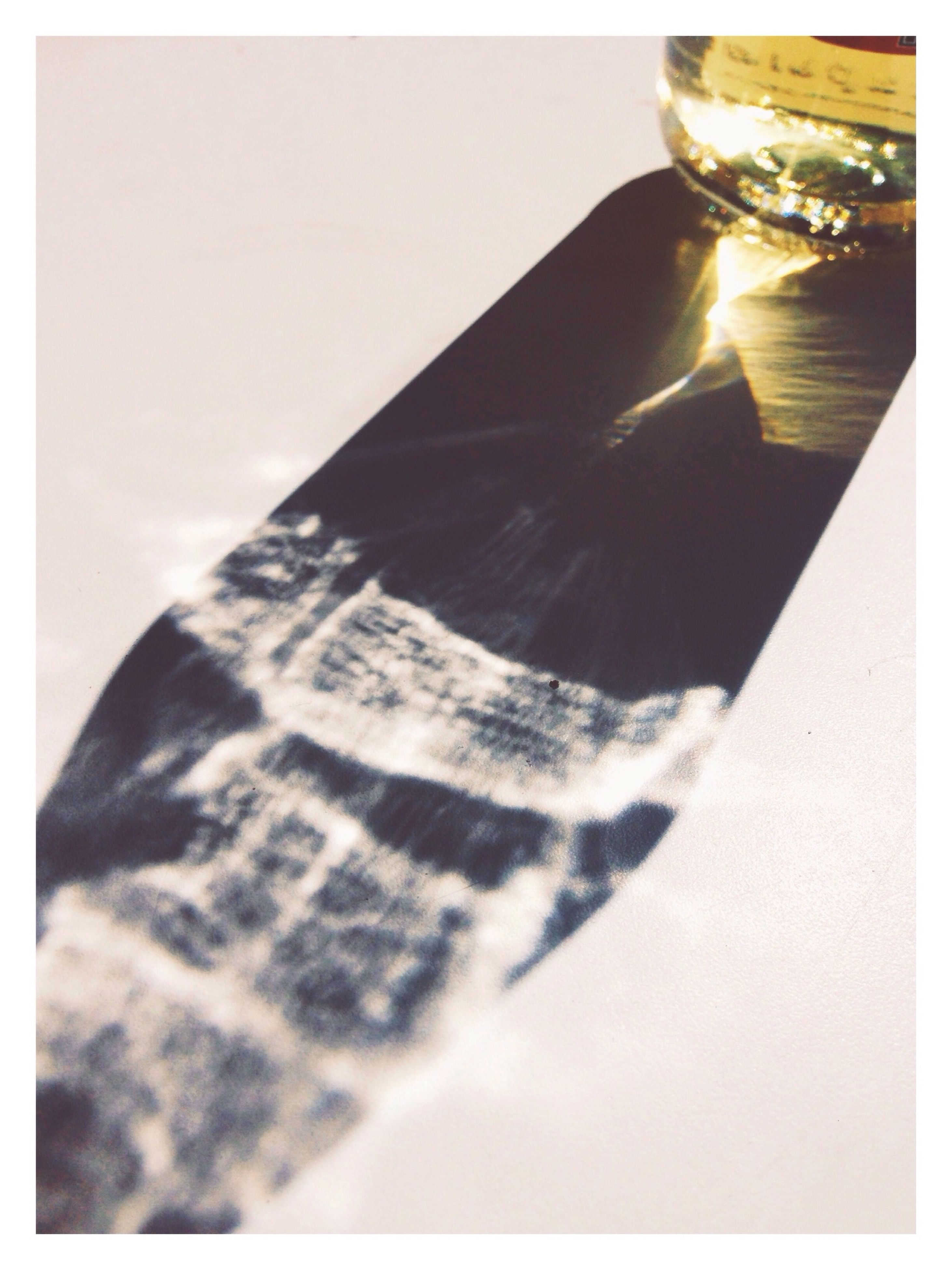 transfer print, auto post production filter, indoors, close-up, sunlight, shadow, single object, no people, still life, part of, selective focus, lens flare, day, high angle view, pattern, low angle view, cropped, copy space, focus on foreground, sunbeam