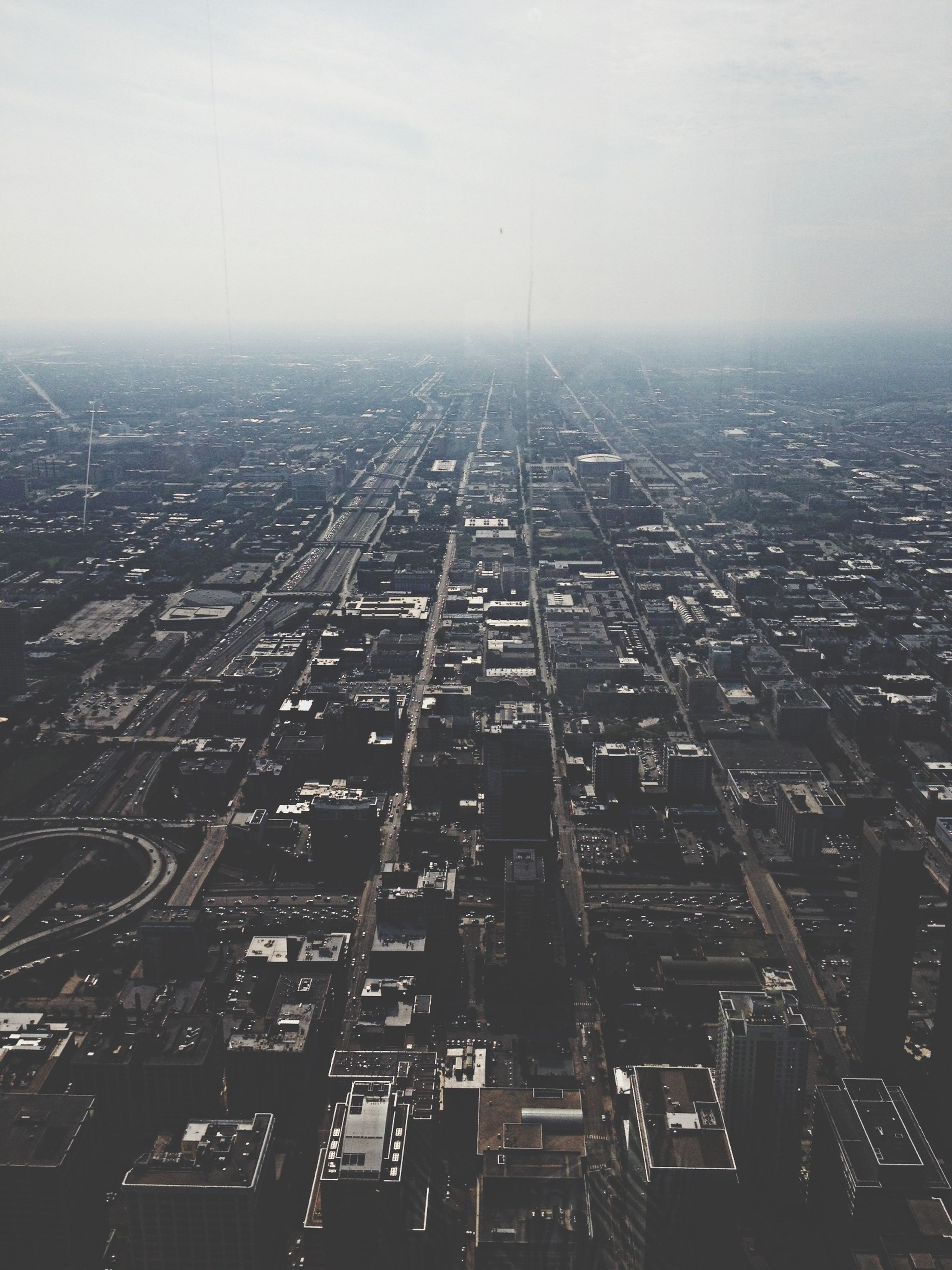 city, architecture, building exterior, cityscape, high angle view, built structure, crowded, aerial view, sky, city life, skyscraper, modern, tall - high, travel, day, travel destinations, outdoors, residential district, capital cities, transportation