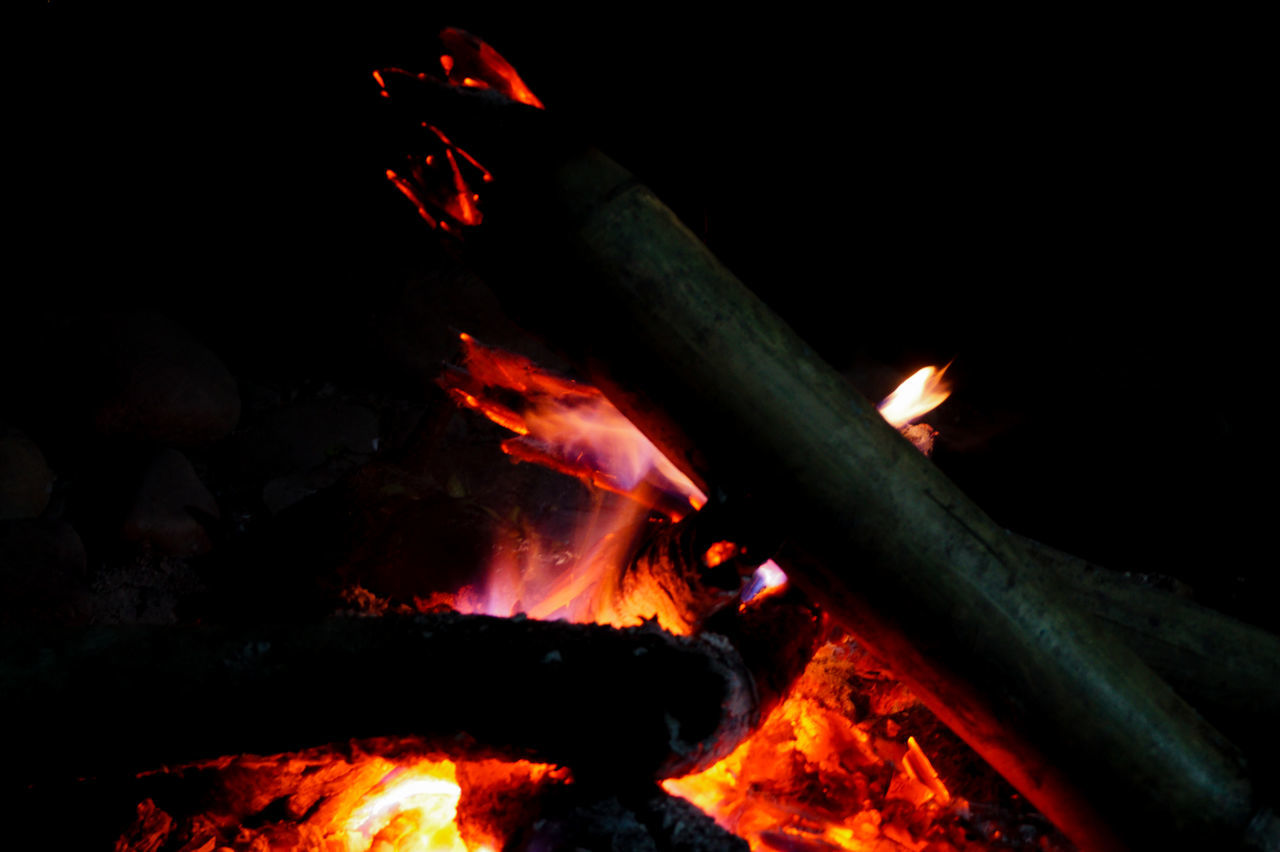 Flames Bonfire Burning Campfire Close-up Color Palette Dark Fire Fire - Natural Phenomenon Fireplace Firewood Flame Glowing Heat Heat - Temperature Illuminated Lit Log Night No People Orange Color Outdoors Wood - Material