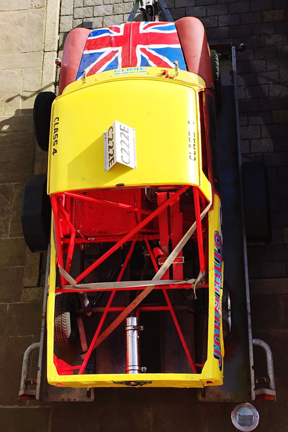 Anyone for a race! No People Day Text Outdoors Car Mini Red Blue Yellow Union Jack Flag Racing Detailed Trailer Framework Decals Colourful All Ready In Need Of Work Bright