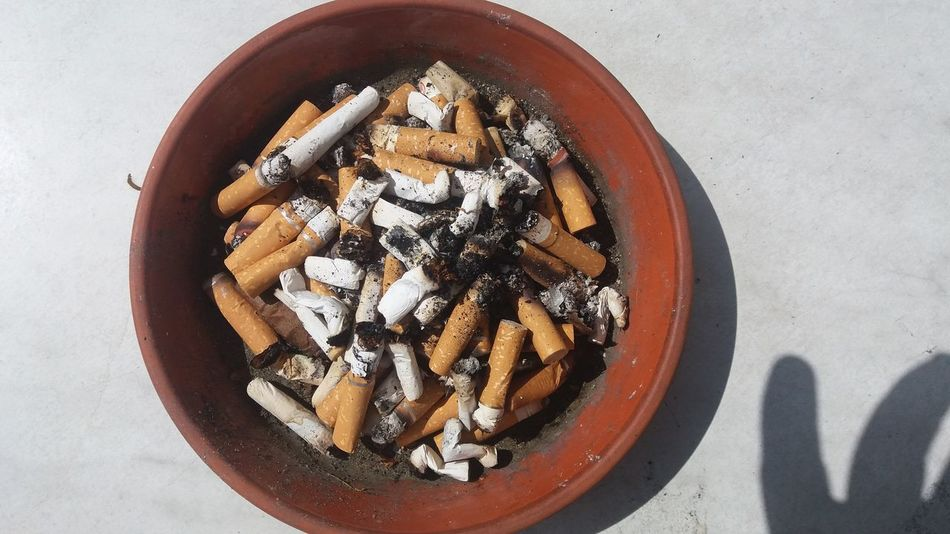 Butt Cigaretts Fag E Fingers Addiction Ash Ashtray  Brown Cigarette End Cigarette, Close-up Directly Above Fag Hand Indulgence No People Obsession Overhead View Shadow Smoke Still Life Temptation