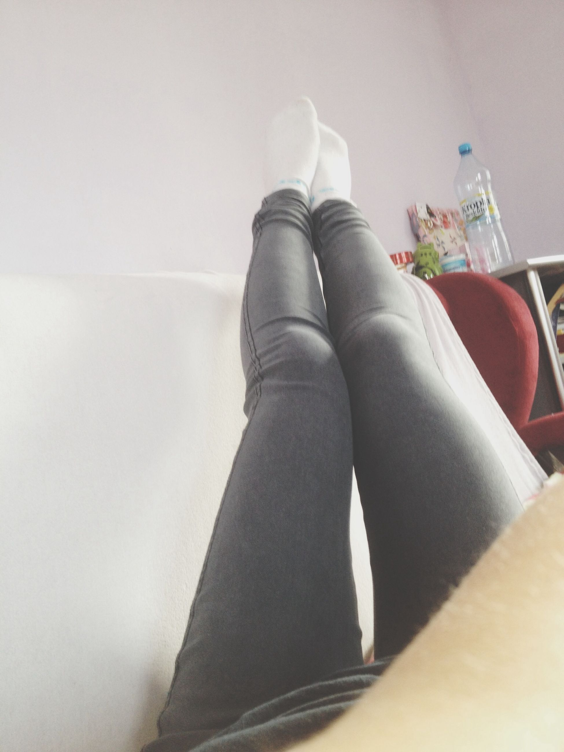 indoors, low section, person, home interior, domestic room, bed, relaxation, flooring, domestic life, shoe, fashion, femininity, bedroom, lifestyles, sensuality, sitting