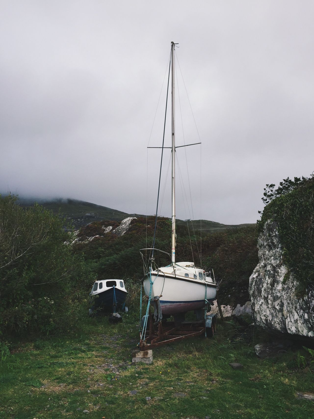 Boats Sky Outdoors Tranquility Tranquil Scene Beauty In Nature Nature No People Scenics Mountain Landscape Mode Of Transport Day Grass Tree Cloud - Sky Nautical Vessel Mast Ship Boat Yacht Ireland
