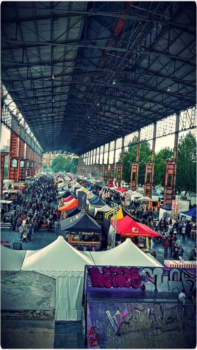 The Photojournalist - 2016 EyeEm AwardsIn the space where once stood a foundry, there is now the international exhibition of street food , 130 stands of different countries cook their typical food. Enjoing A Meal Food Festival International Street Food Festival 2016 International Food Industrial Space Old Factory Industrial Architecture Turin Italy