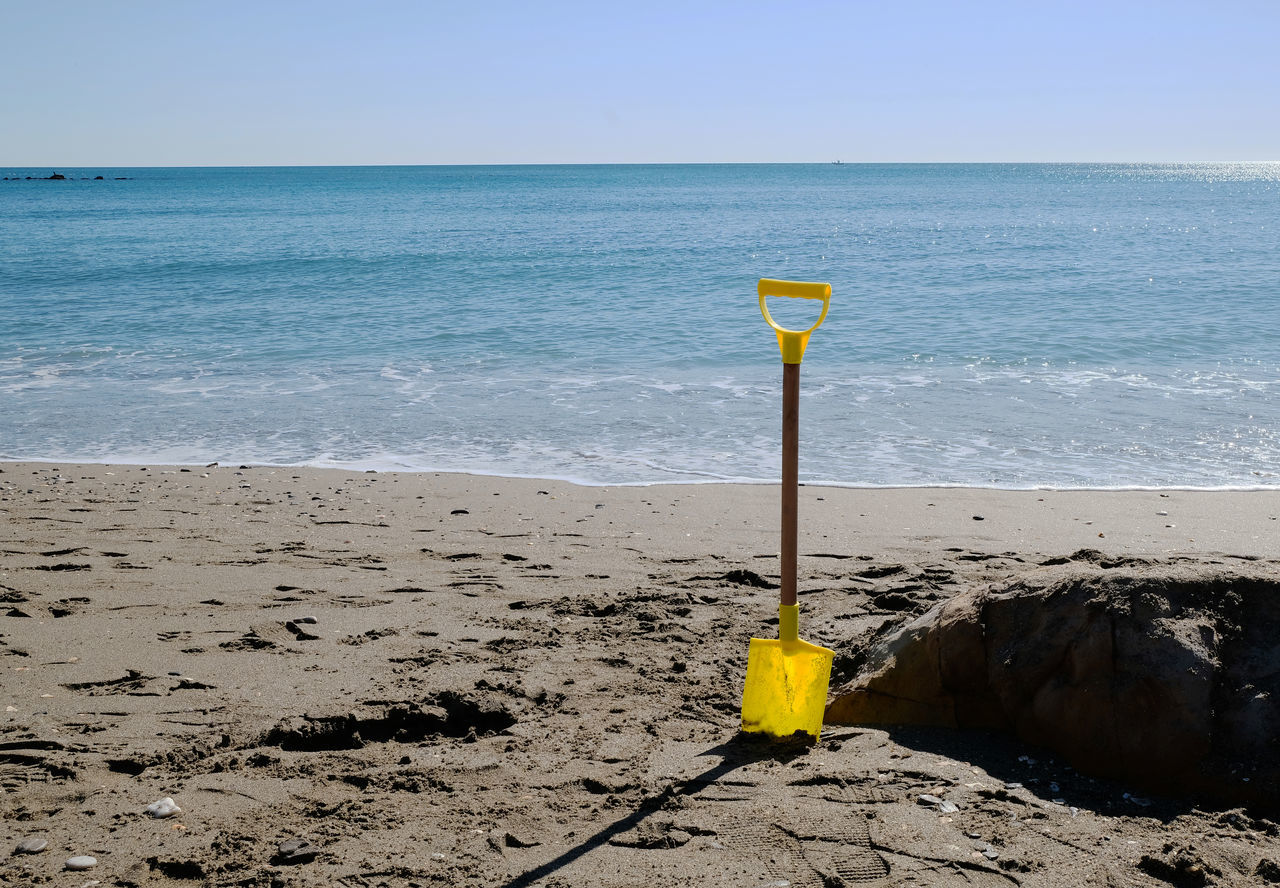 Abandoned Abandonment Beach Beauty In Nature Blue Child`s Play Clear Sky Day Digging Hole Holiday Horizon Over Water No People Outdoors Pit Sand Sea Shovel Live For The Story Toy Travel Water Yellow Yellow Shovel