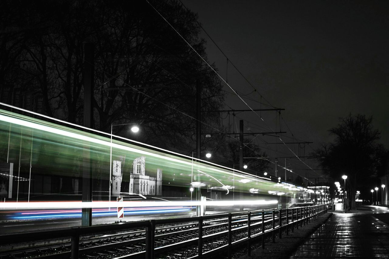 ~🚊✴~ Night Illuminated Motion Speed Transportation Long Exposure Light Trail Architecture Tree Outdoors Sky No People Low Angle View Night Photography Canon Blurred Motion Street Light Road Light And Shadow Getting Inspired Velocity Streetphotography Colorsplash Traffic Lines And Shapes