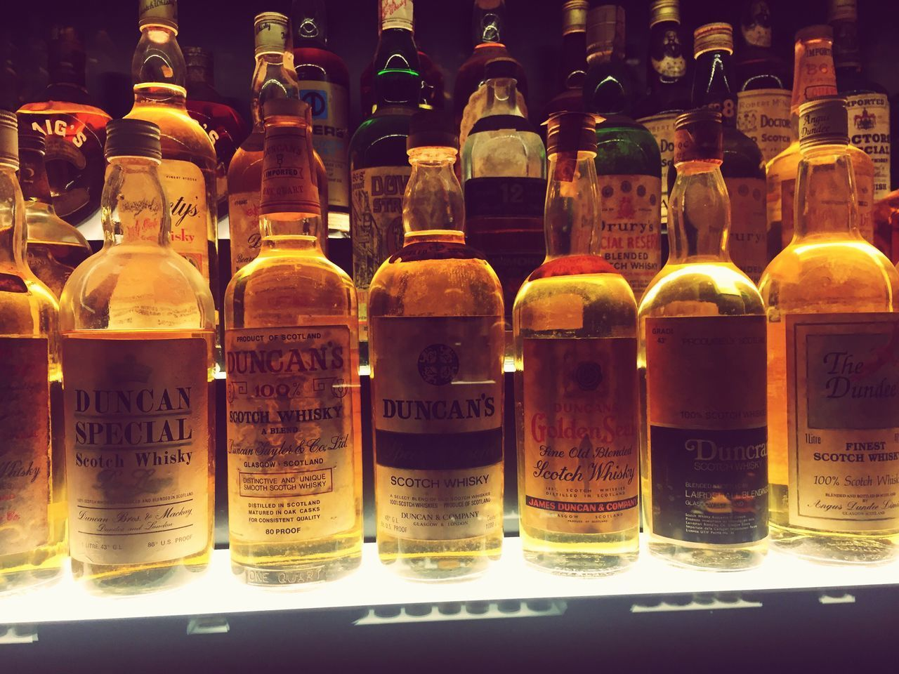 Bottle In A Row Large Group Of Objects Shelf No People Text Whisky Tasting Scotch Whisky Scotch Illuminated Bottles Collection Whiskey C Whisky