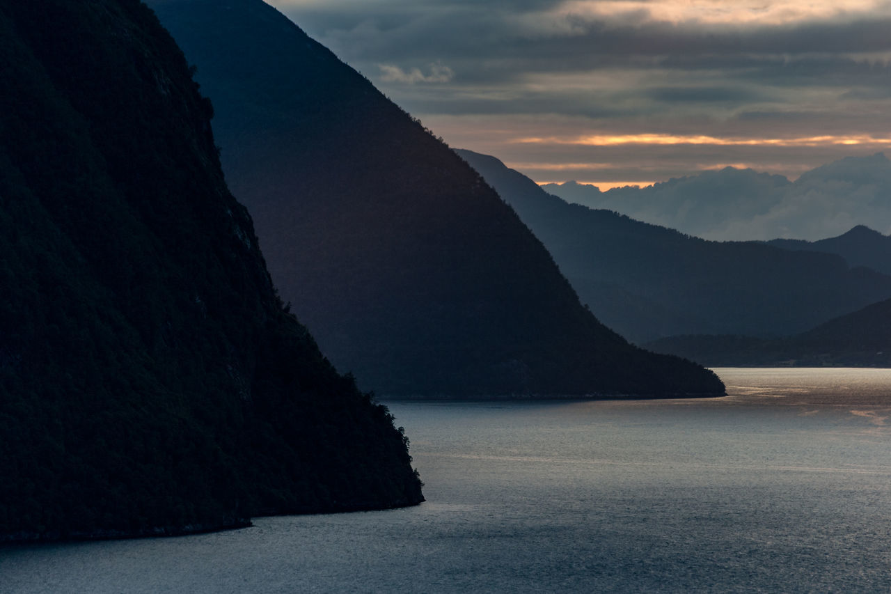 Cloud Dramatic Sky Nature Norway Silhouette Weather Aerial Perspective Beauty In Nature Day Fjord Landscape Mountain Mountain Range Nature Night No People Outdoors Road Scenics Sea Sky Sunset Tranquil Scene Tranquility Water