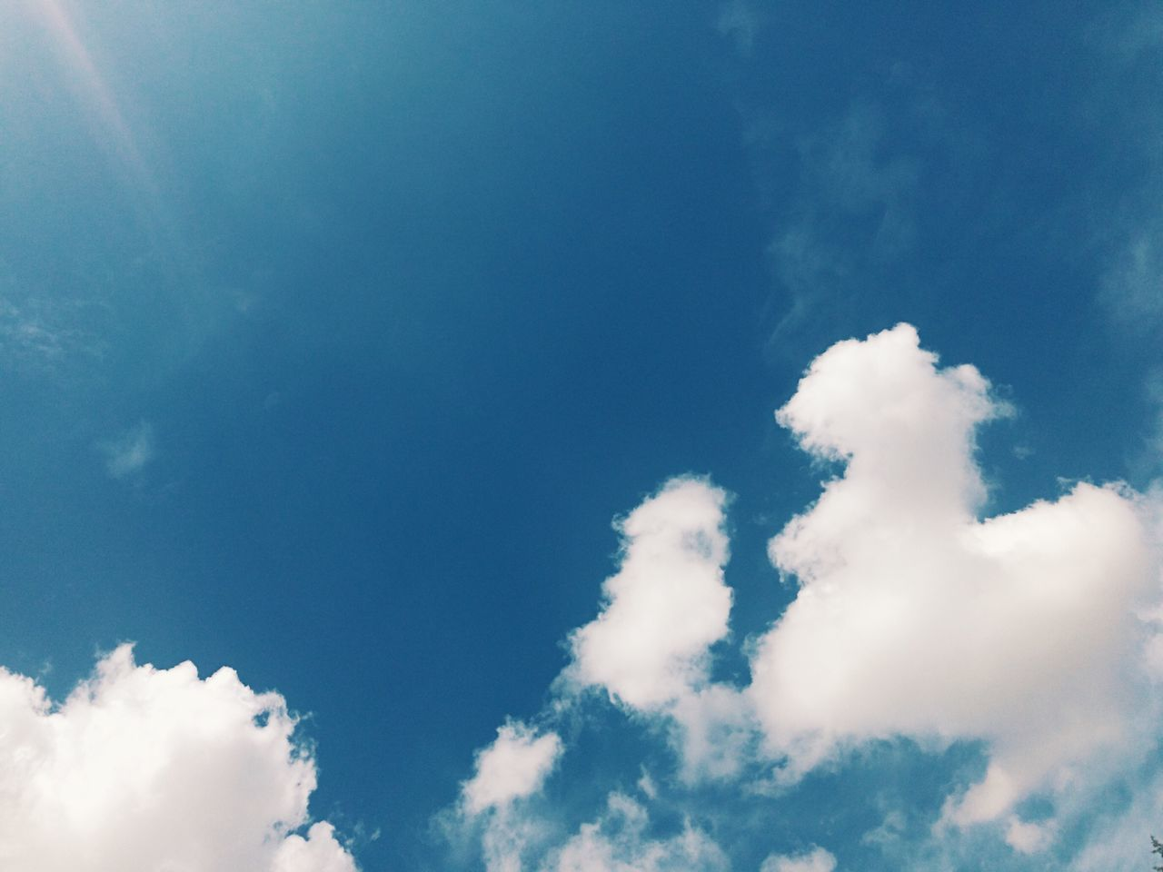 sky, low angle view, nature, cloud - sky, beauty in nature, blue, white color, tranquility, day, backgrounds, sky only, no people, outdoors, scenics
