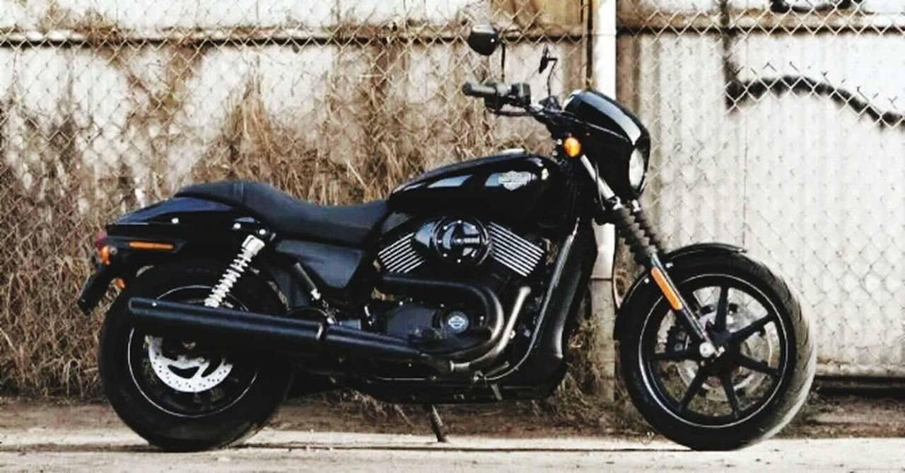 motorcycle, transportation, land vehicle, stationary, outdoors, day, no people