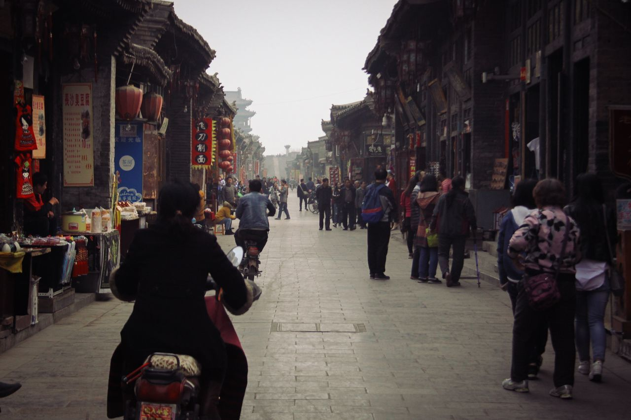 Streets in Pingyao Pingyao China Street Motorbikes Travel Exploring Lifestyles Stone Ancient Culture Travel Destinations Film Rear View Commerce Shops Turism Red Middle Age