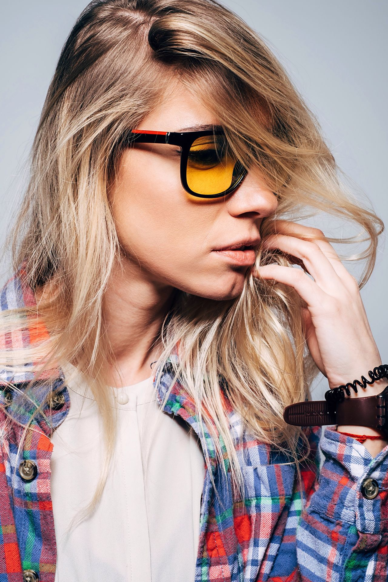 Portrait of a stylish woman Blond Hair One Person Sunglasses Young Adult Long Hair Headshot Young Women Beautiful Woman One Woman Only Portrait Indoors  Accesories