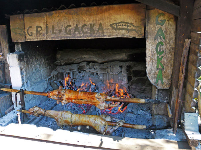 Gacko Polje,Lika,Croatia,Europe,pig and lamb on spit over fire Burning Day Firewood Flame Food Gacka Gastronomy Grill Heat - Temperature Lamb Pig Restaurant Rustic Spit