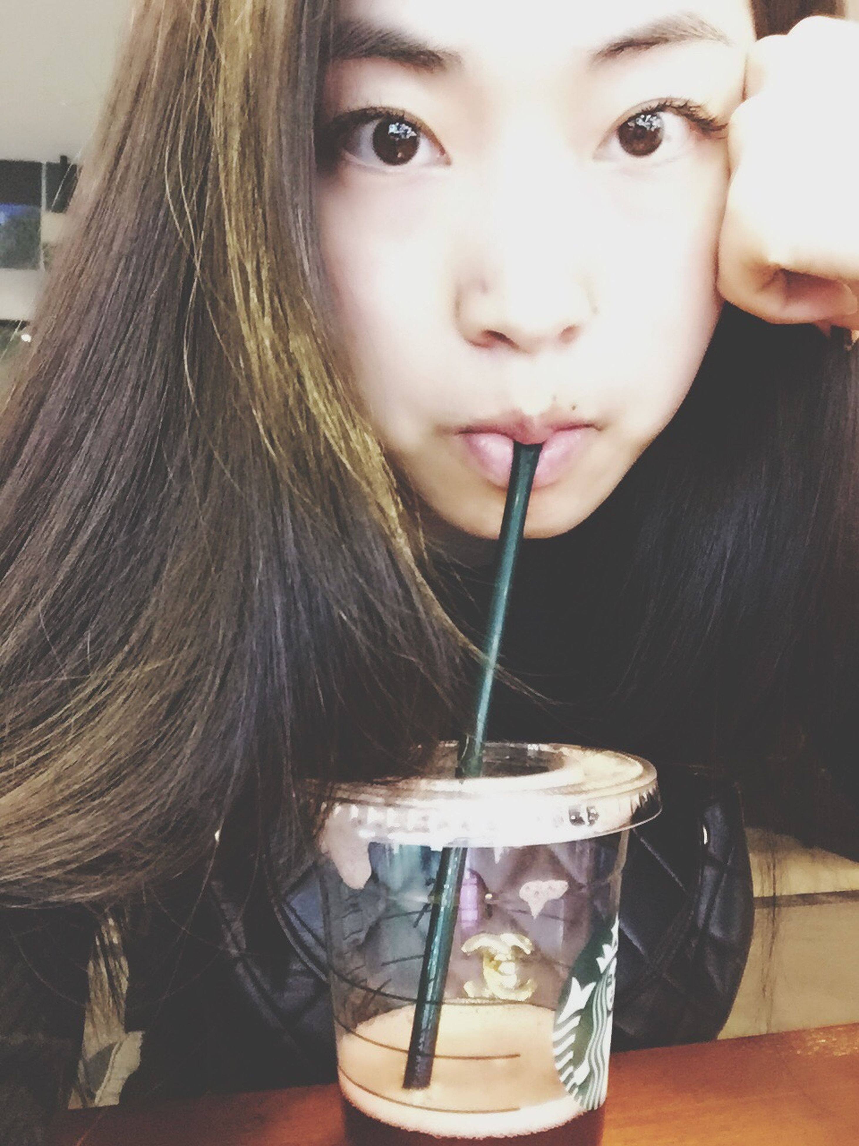 real people, drinking straw, looking at camera, front view, one person, food and drink, childhood, portrait, drinking, headshot, drink, girls, holding, elementary age, lifestyles, close-up, indoors, medium-length hair, food, day, freshness