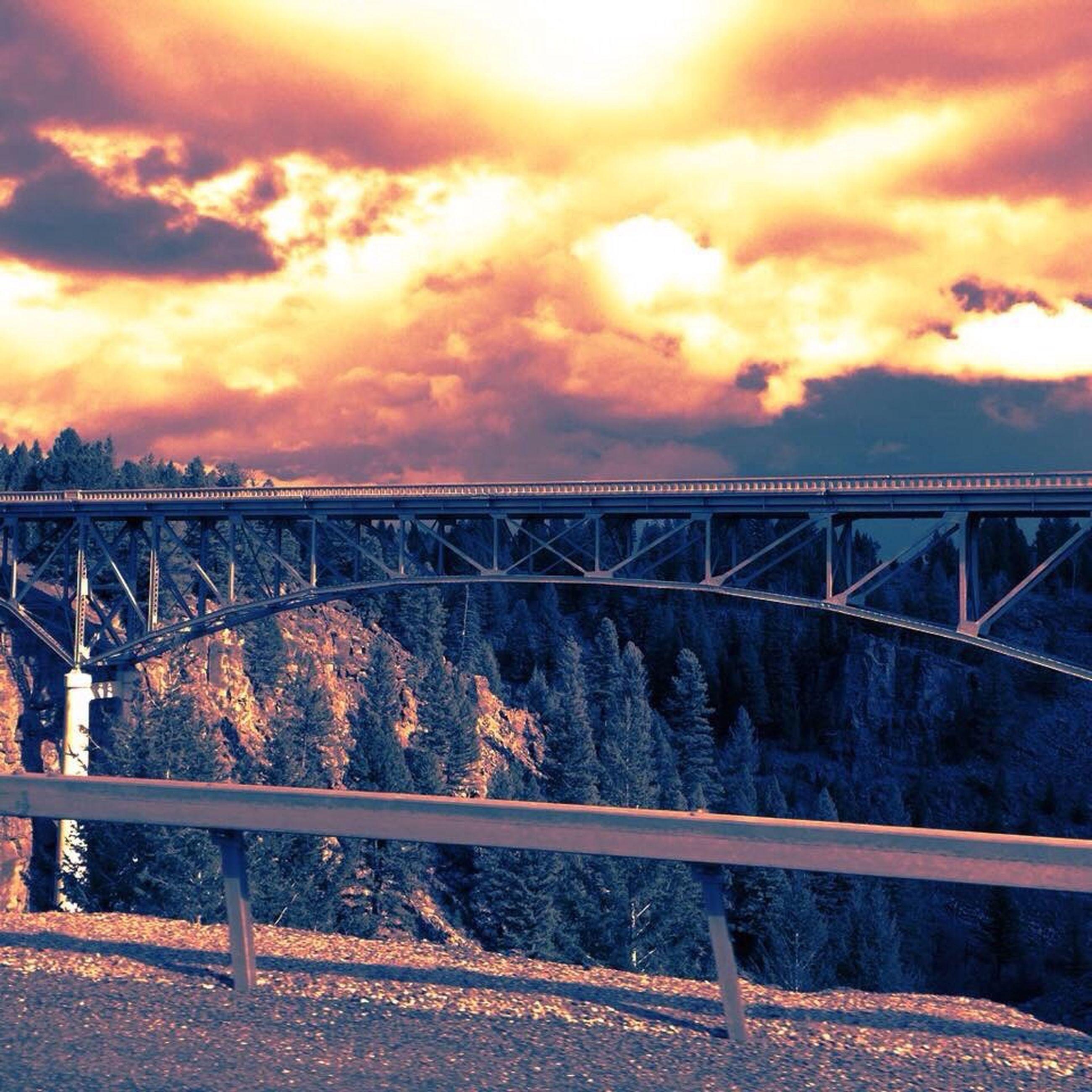 sunset, bridge - man made structure, sky, cloud - sky, connection, orange color, railing, transportation, cloudy, built structure, architecture, bridge, cloud, dramatic sky, rail transportation, metal, railroad track, engineering, nature, no people
