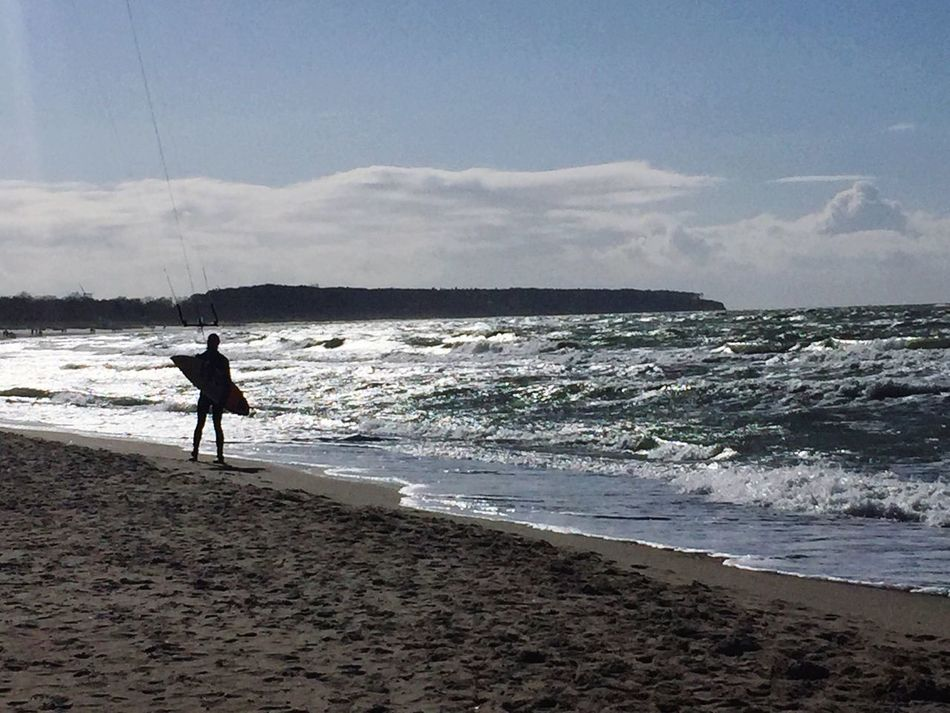 Real People Sea Beach Sand Wave One Person Silhouette Sky And Clouds Leisure Activity Water Men Horizon Over Water Vacations Lifestyles Water Reflections Watersport Wind Sky Nature Beauty In Nature Clear Sky Cloud - Sky Reflection Horizontal Kiteboarding