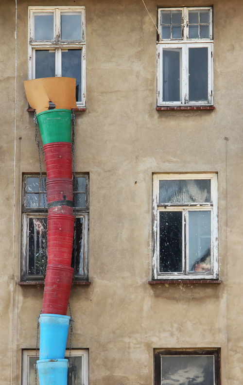 an old house gets some renovation Abandoned Abandoned Places Architecture Beauty Of Decay Building Building Exterior City Cityscape Cityscapes Decay Exterior Eye4photography  Façade Front View GDR Multi Colored No People Old Buildings Renovation Tadaa Community Urban Geometry Urban Landscape Window Windows