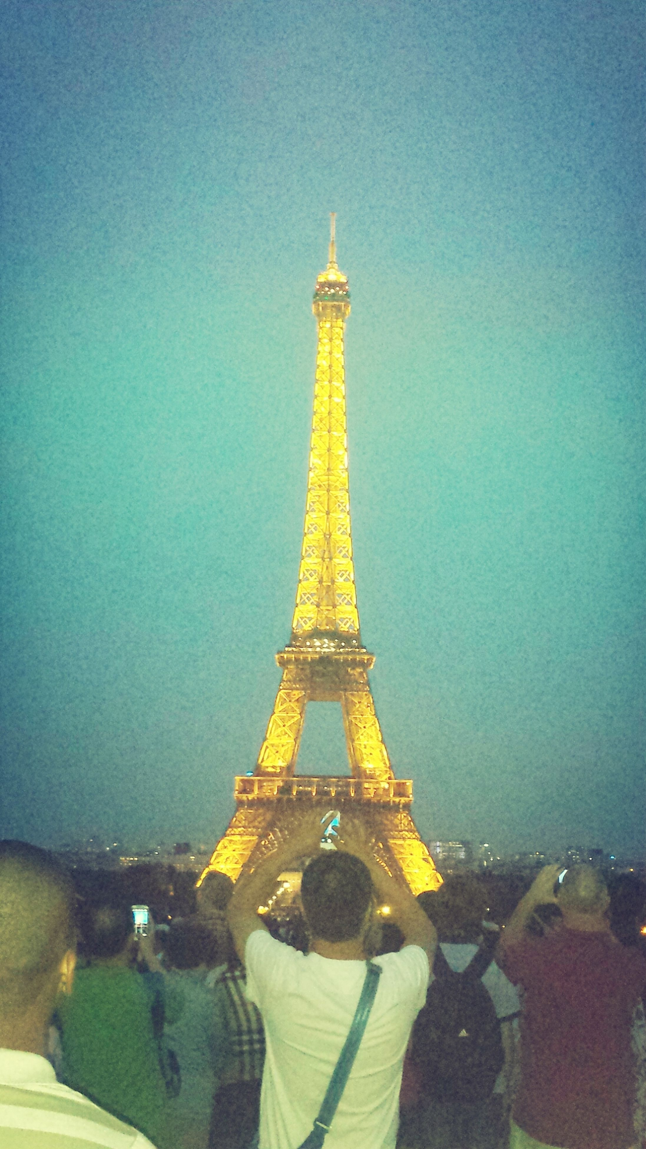 famous place, international landmark, tower, architecture, built structure, eiffel tower, travel destinations, tourism, capital cities, tall - high, travel, clear sky, building exterior, sky, culture, blue, copy space, history, city, tall
