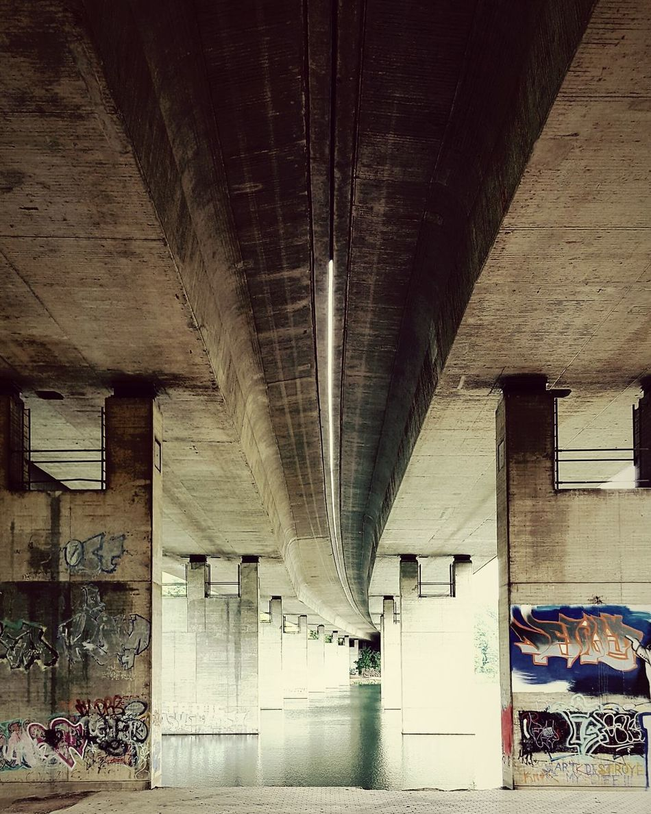 Under The Bridge Bridge Over Water Perspective From My Point Of View The Following EyeEm Gallery EyeEm Best Edits Graffiti Wall Bridge Graffiti The Architect - 2016 EyeEm Awards Architecture Architecture_collection Highwaybridge Quiet Moments Transportation The Great Outdoors - 2016 EyeEm Awards