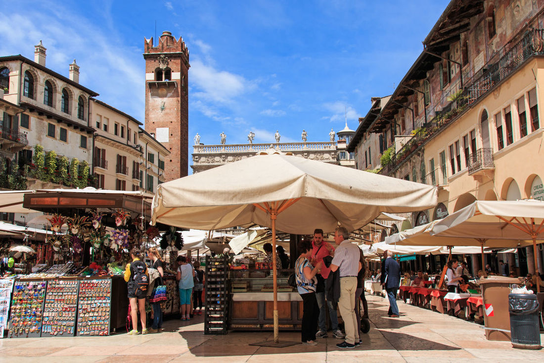 Piazza delle Erbe, Verona, Italy Architecture Arena Building Exterior Built Structure City City City Life Coluseum Crowd Italy Large Group Of People Leisure Activity Lifestyles Market Market Stall Men Person Retail  Romeo And Juliet Shopping Small Business Store Street Market Tourist Verona