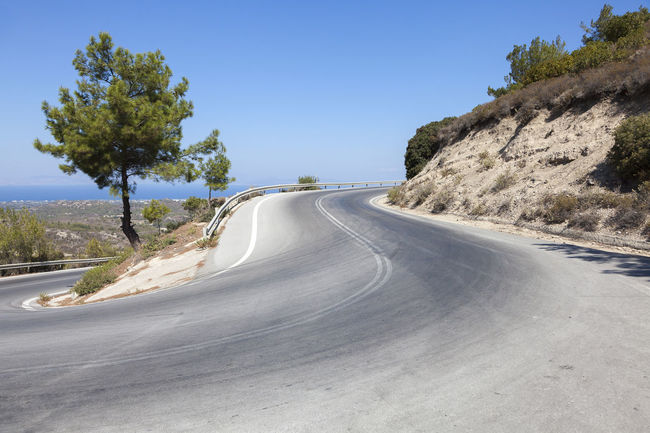 Rhodes Road Greece Beauty In Nature Day Growth Holiday Holidays Horizontal Landscape Nature No People Outdoors Rhodes Rhodos Road Sky Street Tree Trip Vacations Winding Road