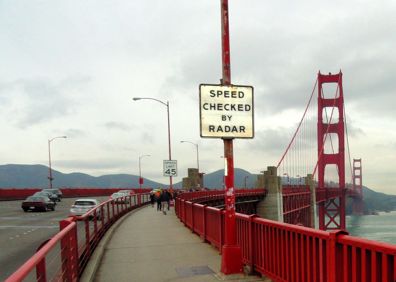Architecture Bridge - Man Made Structure Built Structure City Cloud Cloud - Sky Connection Day Diminishing Perspective Full Length Golden Gate Bridge Harbor Pier Promenade Rear v Speed Limit Sign iew Road Road Sign Sea Sky Speed Checked By Radar The Way Forward Transportation Walking Water