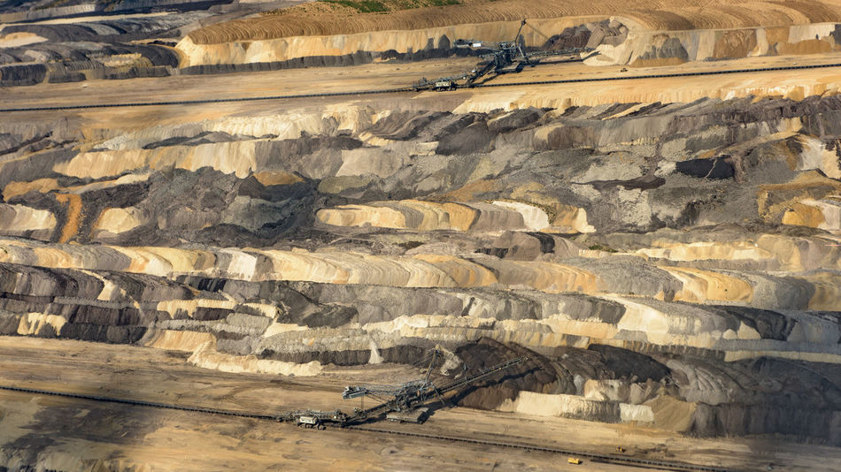 Bird's eye view of the Etzweiler mine. This hole in the earth, is as big a small city. A Bird's Eye View Abstract Colors Colourful Colours Earth Etzweiler EyeEm Best Shots From Above  Lines Mine No One No People Open Mine Open-cast Mining Open-cut Mining Open-pit Mining Polution