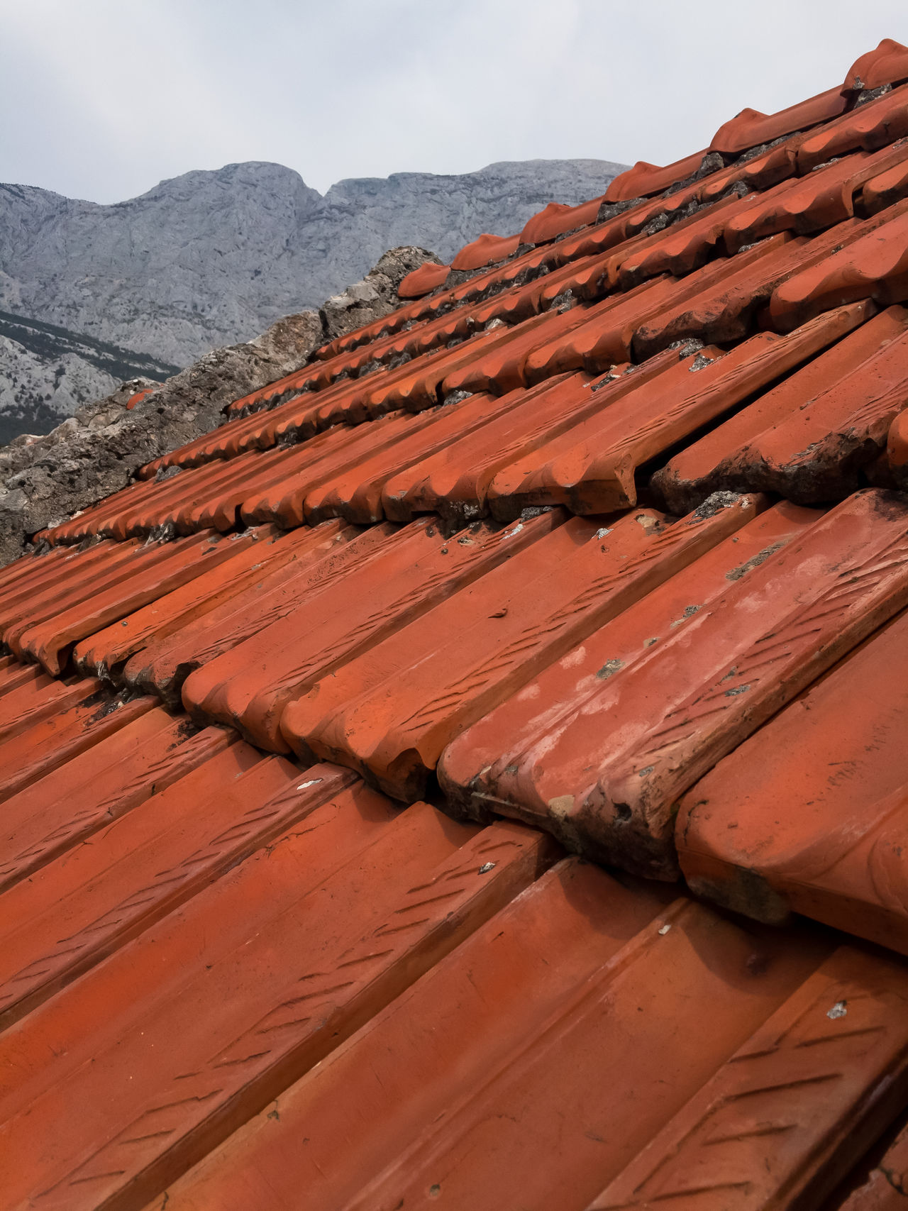 Old red roof tiles with mountain at background Architecture Construction Cover Exterior House Mediterranean  Mountain No People Nobody Old Outdoors Pattern Red Roof Roofing Rooftop Row Texture Tile Tiled Tiles Top Traditional
