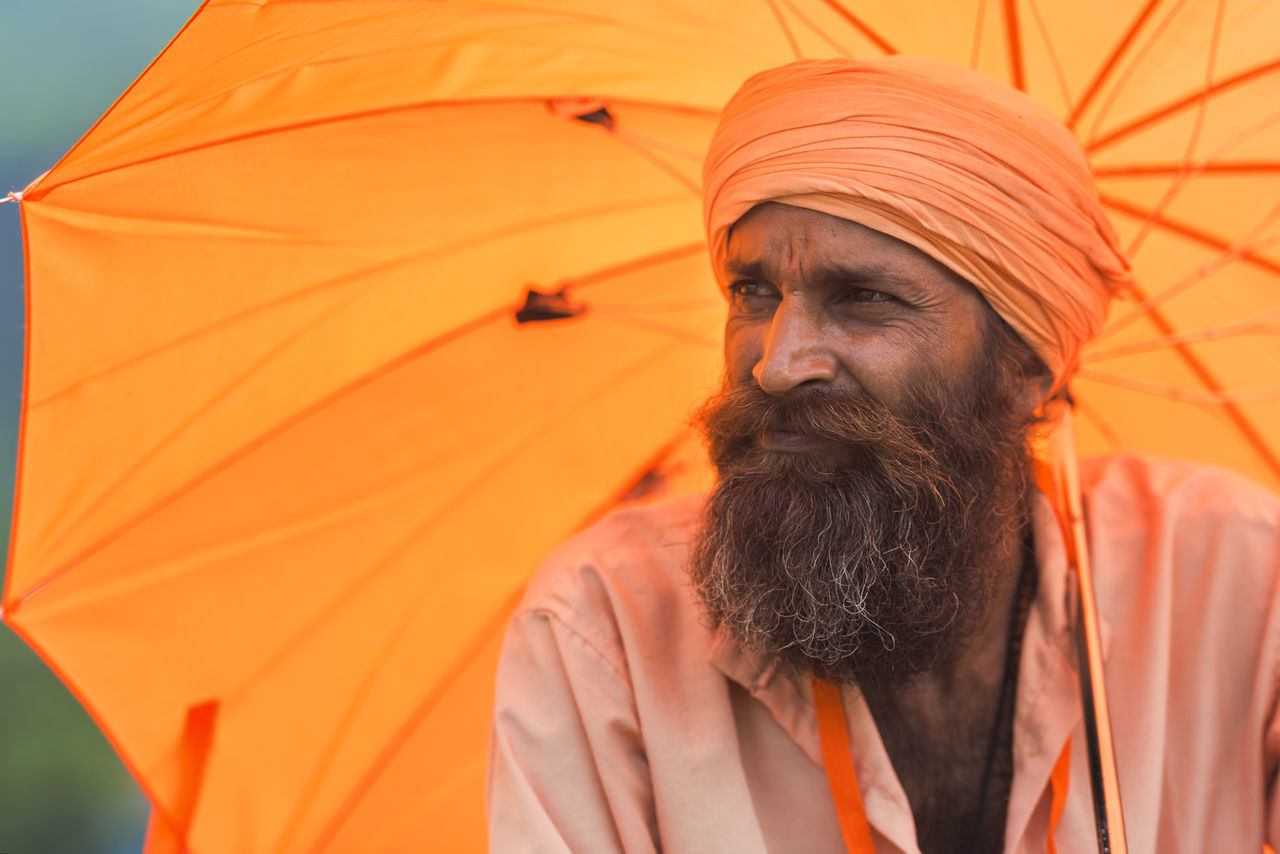 A sadhu at Trimbakeshwar during Kumbhmela 2015. 2015  Beard India Kumbhmela Men Nashik Orange Portrait Sadhu Sage Showcase: December Trimbakeshwar Umbrella Colours Of Life The Portraitist - 2016 EyeEm Awards TakeoverContrast