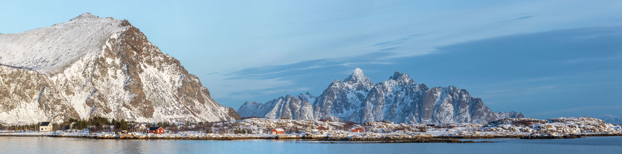 Beauty In Nature Cold Temperature Dramatic Landscape Dramatic Sky Evening Fjord Frozen Houses Landscape Lofoten Mountain Mountain Range Nature Norway Outdoors Panorama Scenics Sea Sky Snow Snowcapped Mountain Travel Destinations Vacations Village Water