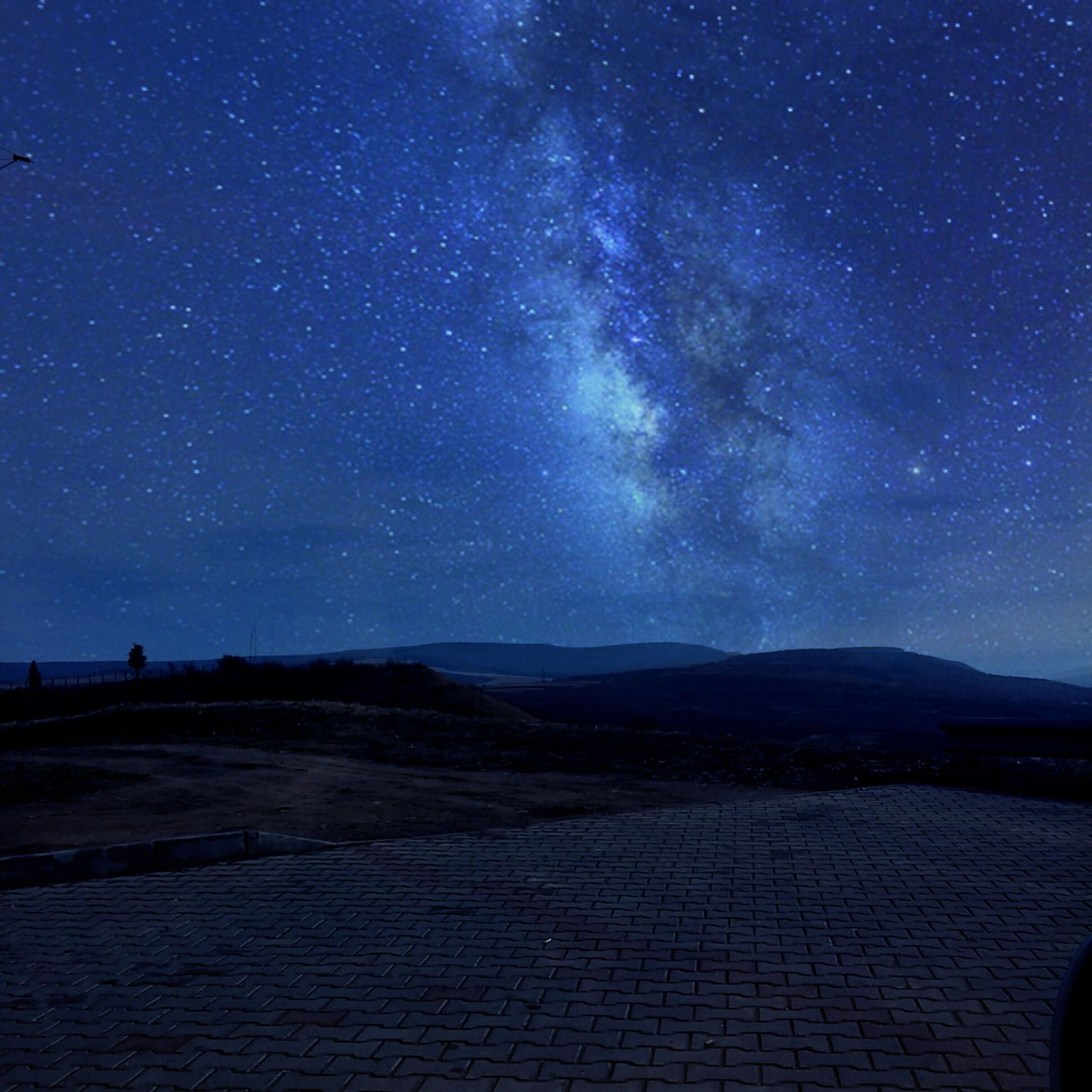 night, tranquil scene, sky, tranquility, star - space, scenics, beauty in nature, star field, landscape, astronomy, blue, nature, infinity, dark, galaxy, idyllic, road, star, illuminated, outdoors