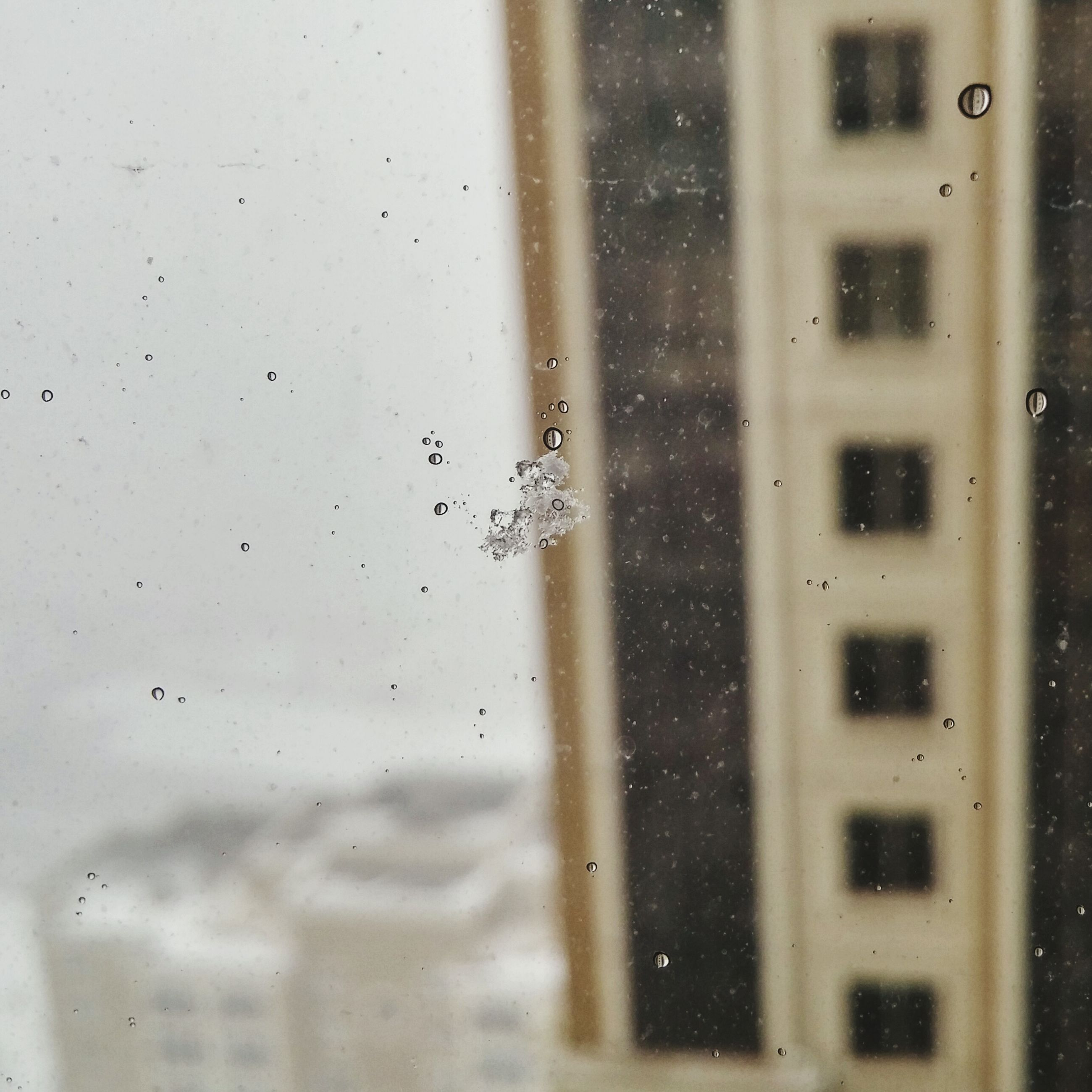 window, drop, indoors, glass - material, transparent, wet, full frame, backgrounds, rain, water, architecture, built structure, weather, raindrop, glass, focus on foreground, building exterior, no people, day, close-up