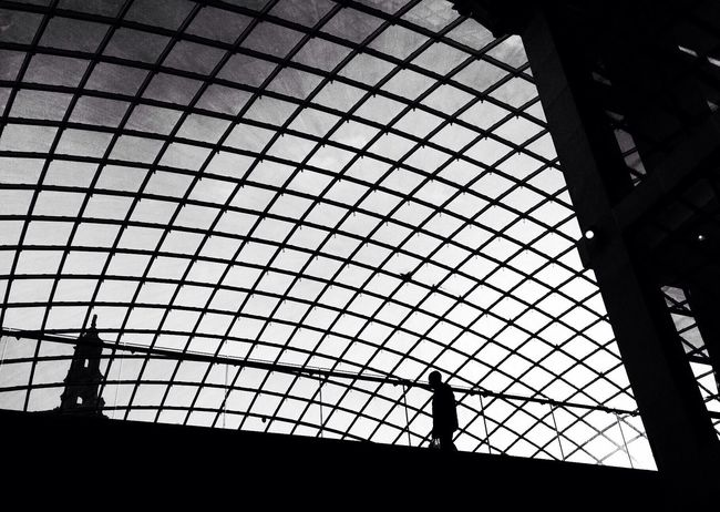 Silhouettes in a Leeds shopping centre. The Architect - 2016 EyeEm Awards Leeds Urban Urban Geometry Architecture Architecture_collection Architecture_bw Silhouette Abstract Modern Architecture Modern Streetphotography Streetphoto_bw Street Photography Blackandwhite Black And White Black & White City Life Low Angle View Blackandwhite Photography Man Alone Alone In The City