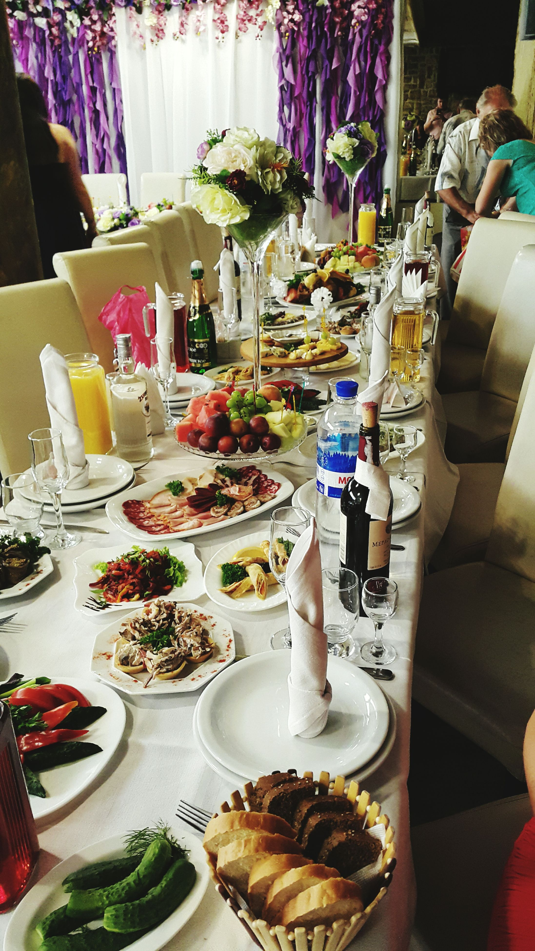 indoors, table, food and drink, food, restaurant, freshness, chair, plate, still life, dining table, drink, place setting, drinking glass, incidental people, ready-to-eat, high angle view, variation, absence, healthy eating, sidewalk cafe