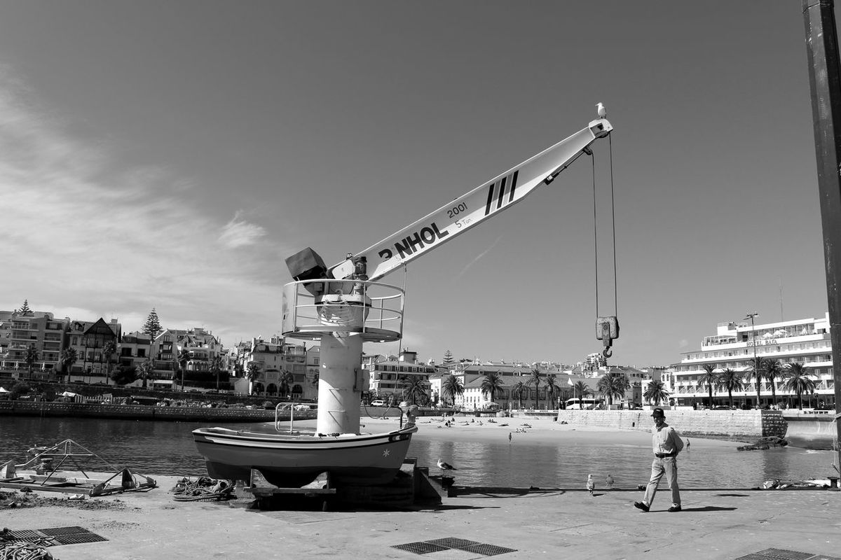 Buildings Crane Dockside Calm Sea Sky And Clouds Eye4photography  EyeEm Blackandwhite Eye4black&white  EyeEm Best Shots People Seaside Eyeemphotography Black & White EyeEmBestPics Urban Landscape Taking Photos Baia De Cascais Portugal