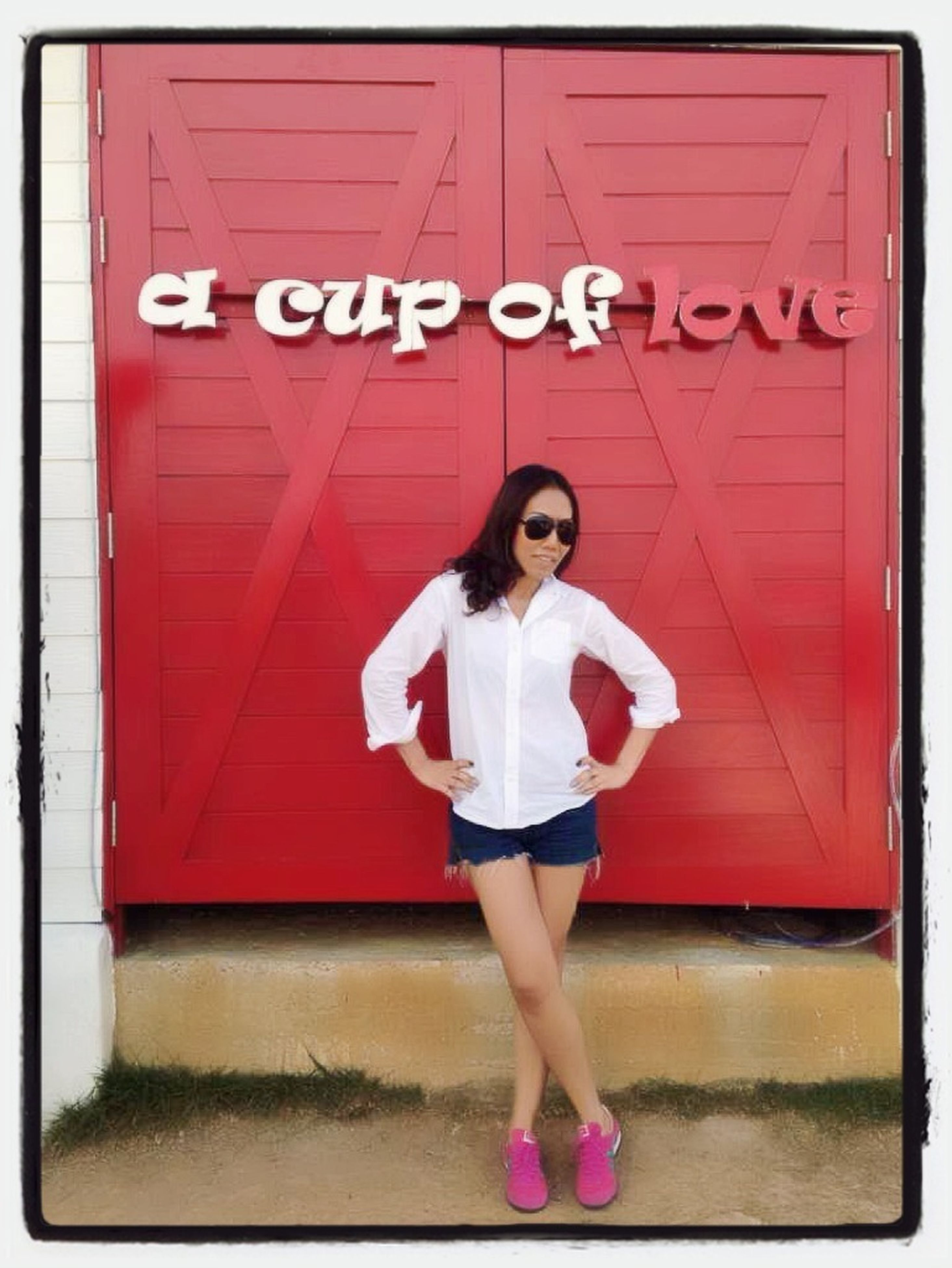 full length, person, lifestyles, casual clothing, young adult, young women, standing, leisure activity, front view, red, looking at camera, holding, portrait, childhood, three quarter length, smiling, girls, wall - building feature