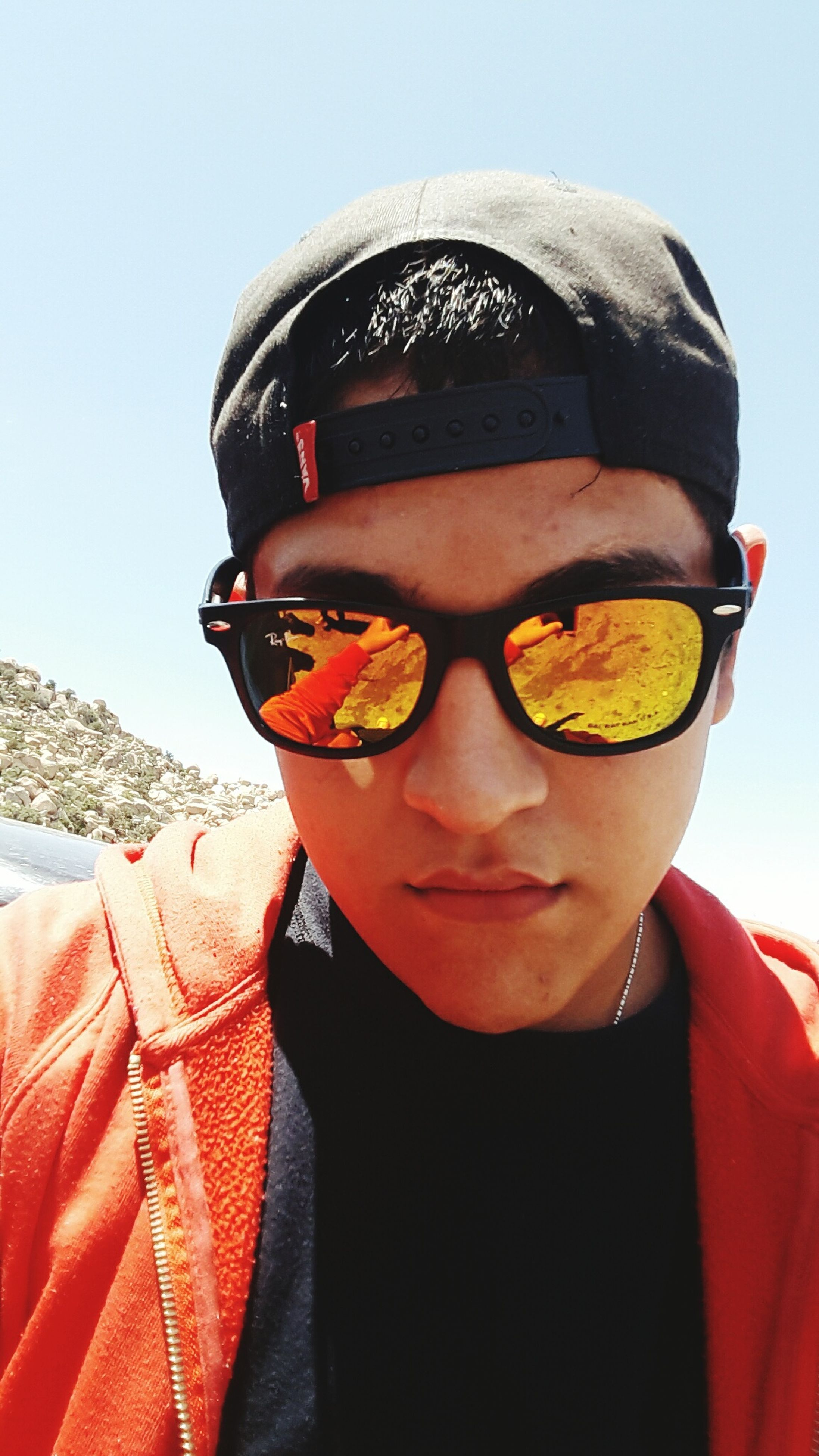 lifestyles, leisure activity, sunglasses, casual clothing, front view, looking at camera, young adult, portrait, person, headshot, young men, holding, hat, clear sky, cold temperature, close-up, warm clothing, cap