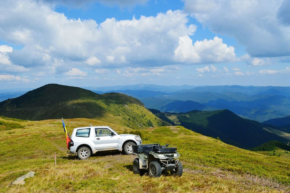 Cars Offroad Cloud - Sky Transportation Car Mountain Landscape Mode Of Transport Sky No People Land Vehicle Nature Outdoors Day Blue Perfectview Taking Photos Sun Relaxing Nature Clouds And Sky Cloudscape Mountains