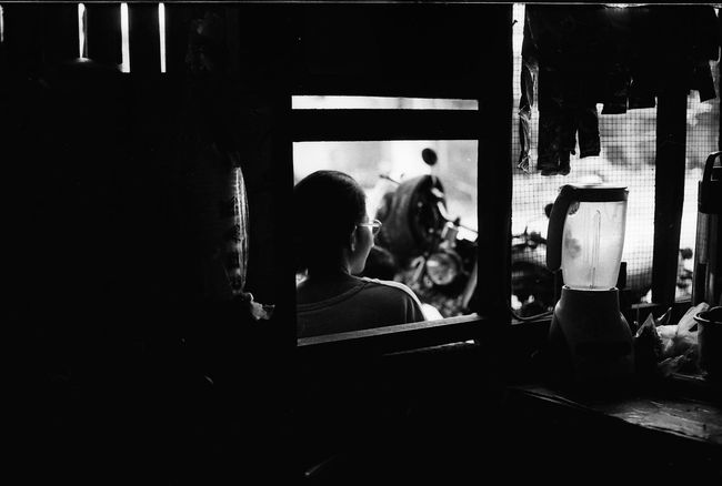 warung life continued 35mm Film Analogue Photography B&w Street Photography Bali, Indonesia City Life Dark Contrast Daytime Faceless Portrait Filmisnotdead Kitchen Scene Leisure Activity Lifestyles Looking Away Looking Out The Window Motorcycle Ordering Food Person In A Window Portrait Of A Woman Restaurant Kitchen Streetphotography Warung Life Young Woman Cinematic Mood Framed Blender