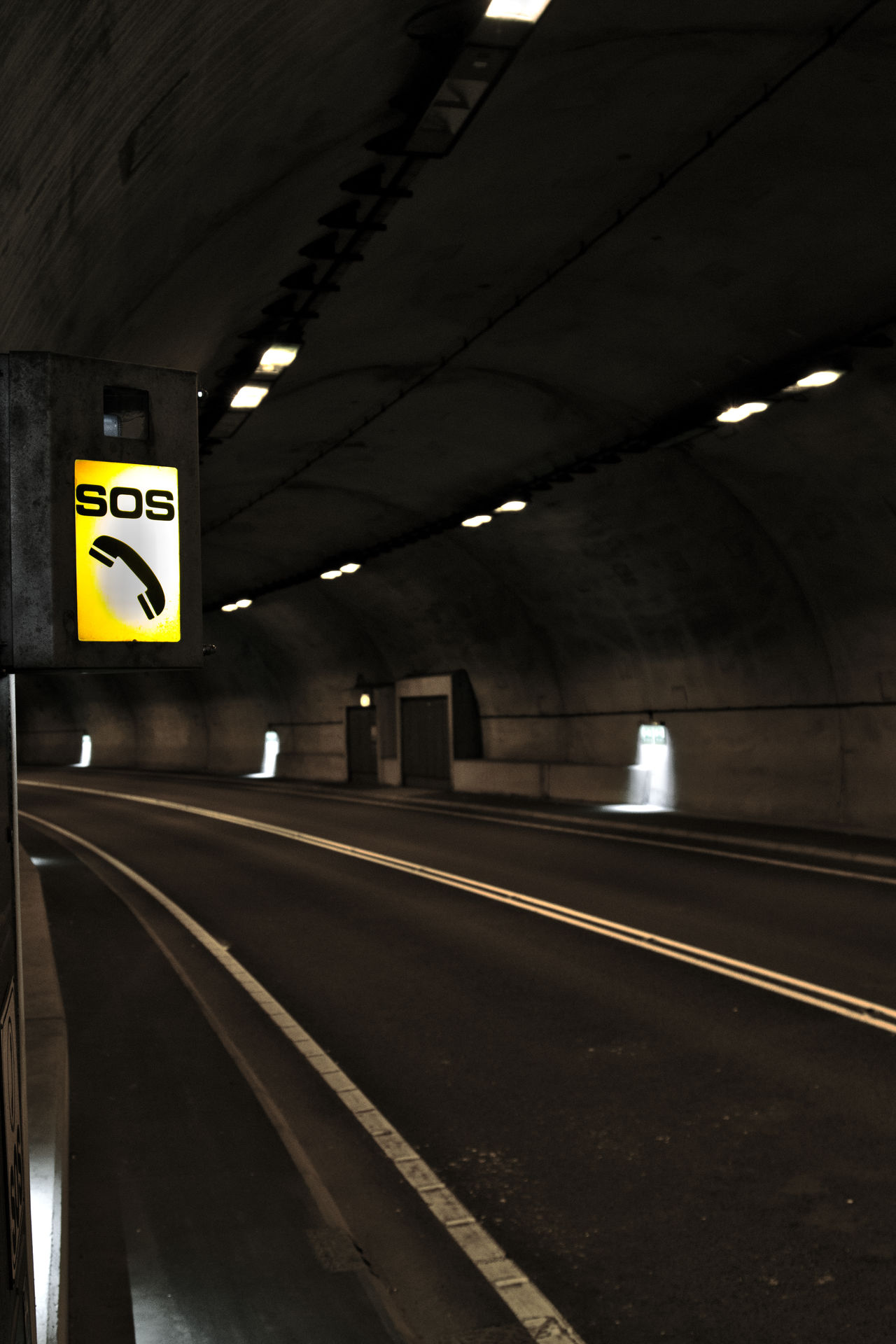 tunnel SOS Concrete Darkness And Beauty Darkness And Light Guidance Illuminated Inside Things Journey Leading Lines Light In The Darkness Man Made Structure Public Transportation Rail Transportation Railroad Station Railroad Station Platform Railroad Track Road Road Sign Signs Sos The Way Forward Transportation Travel Travel Destinations Tunnel Tunnel Vision
